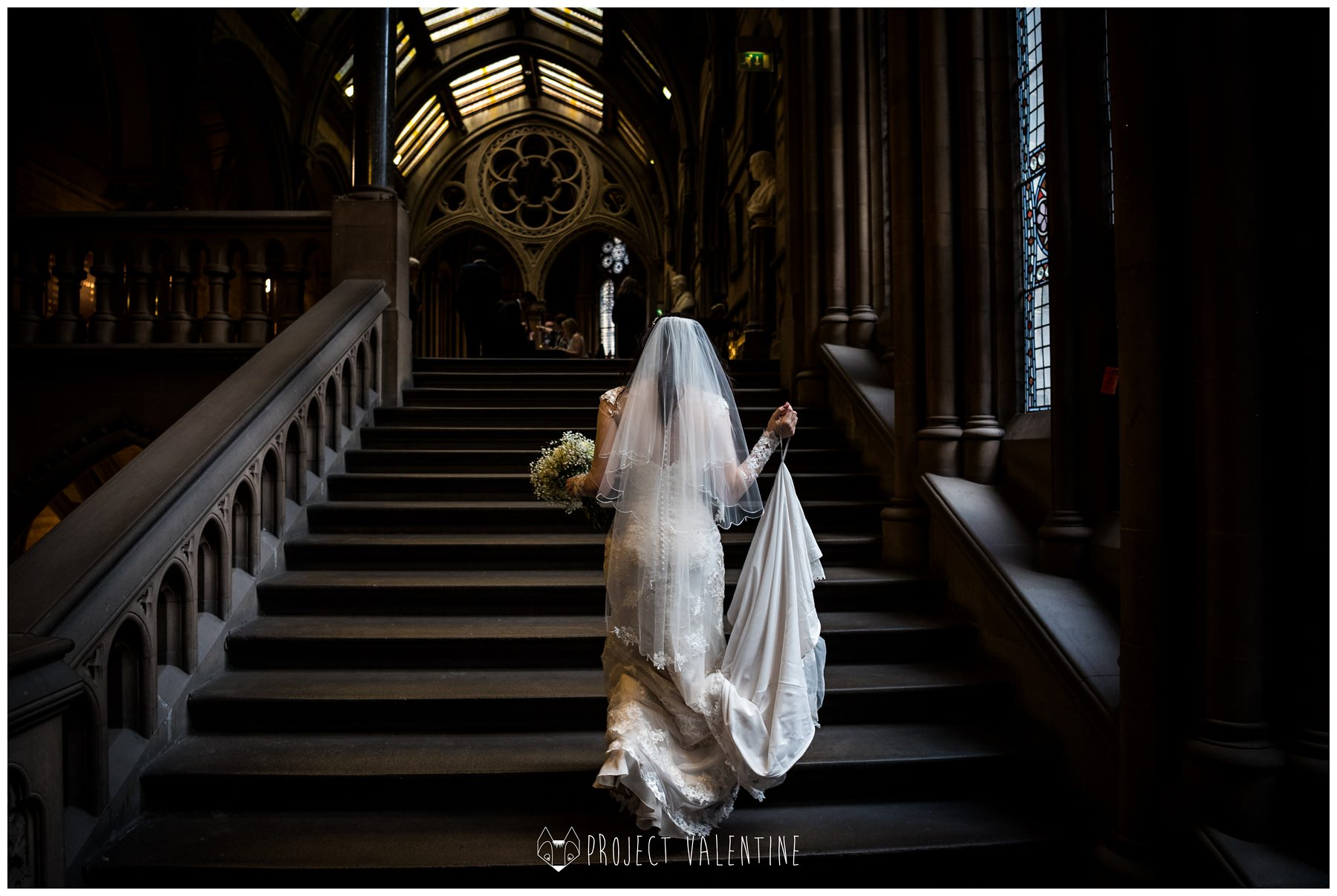 bride walking up the stairs in manchester town hall