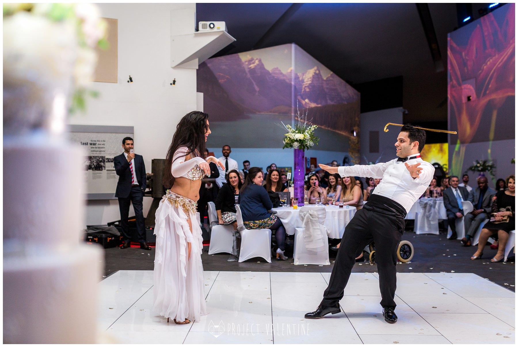 groom dancing with belly dancer