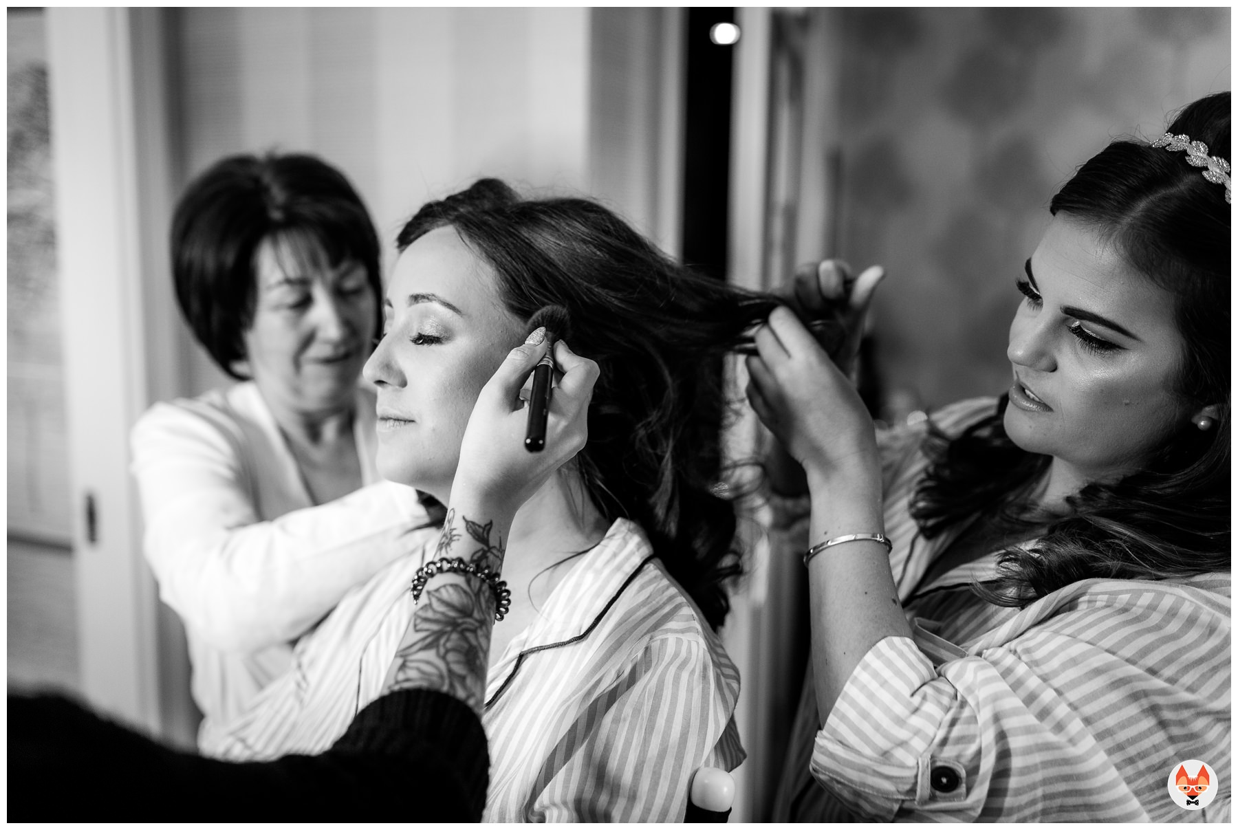 bride having her hair and makeup done