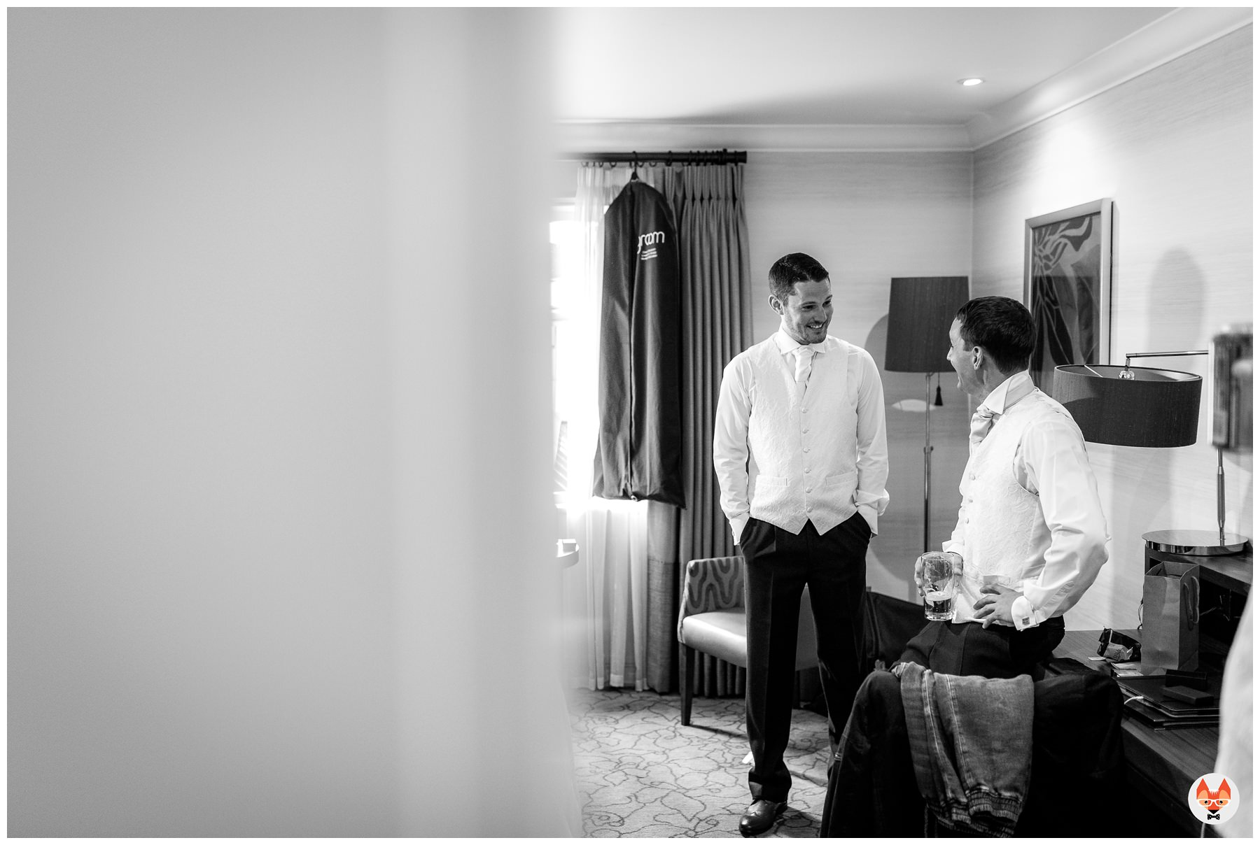groom talking to bestman