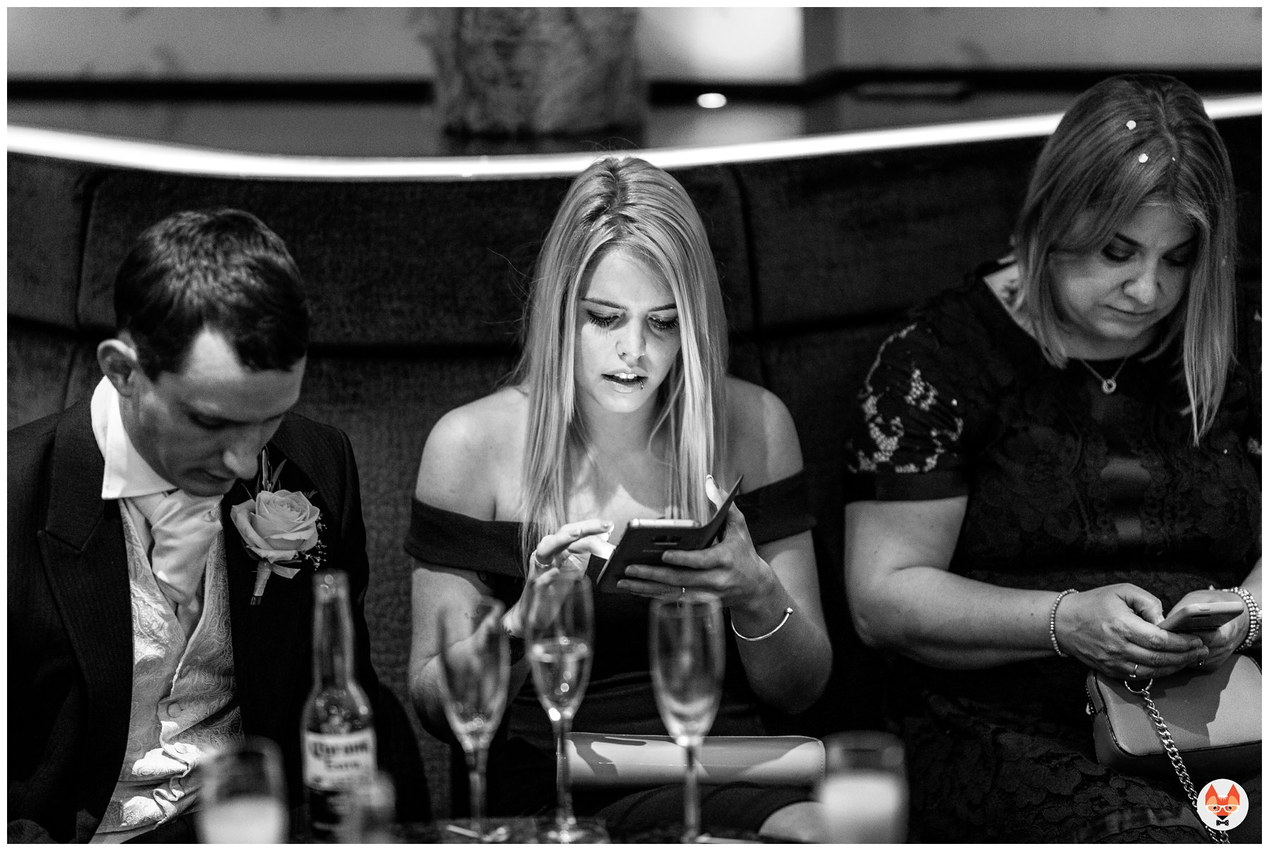 wedding guest on their phone