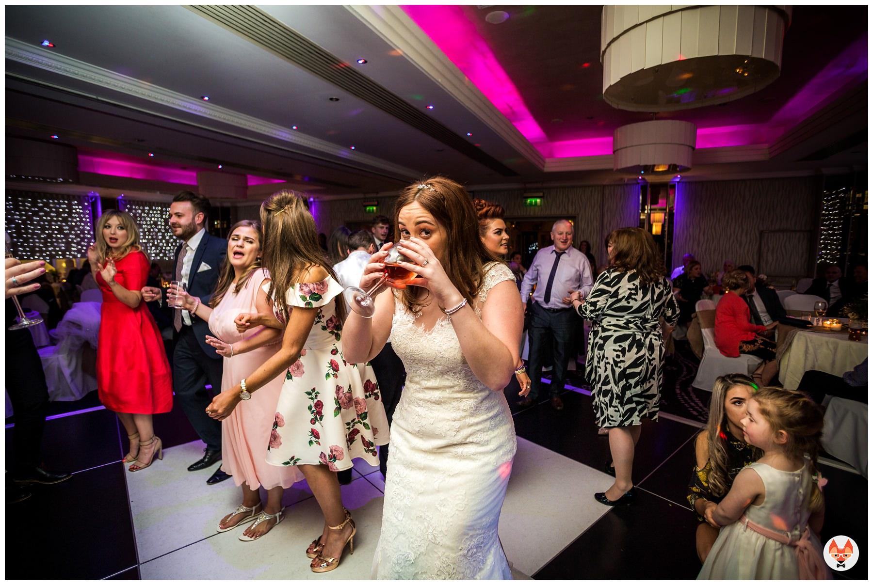 bride caught on dance floor with wine