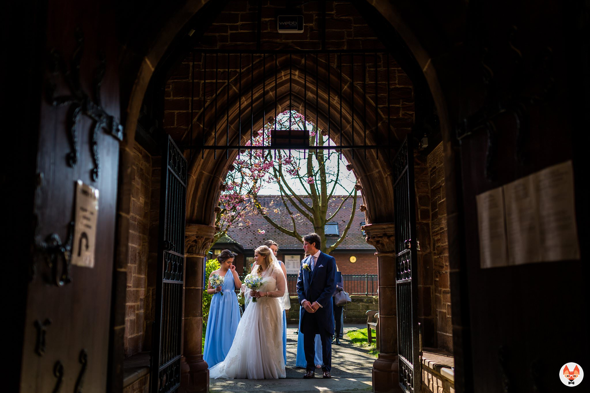bride in archway to church