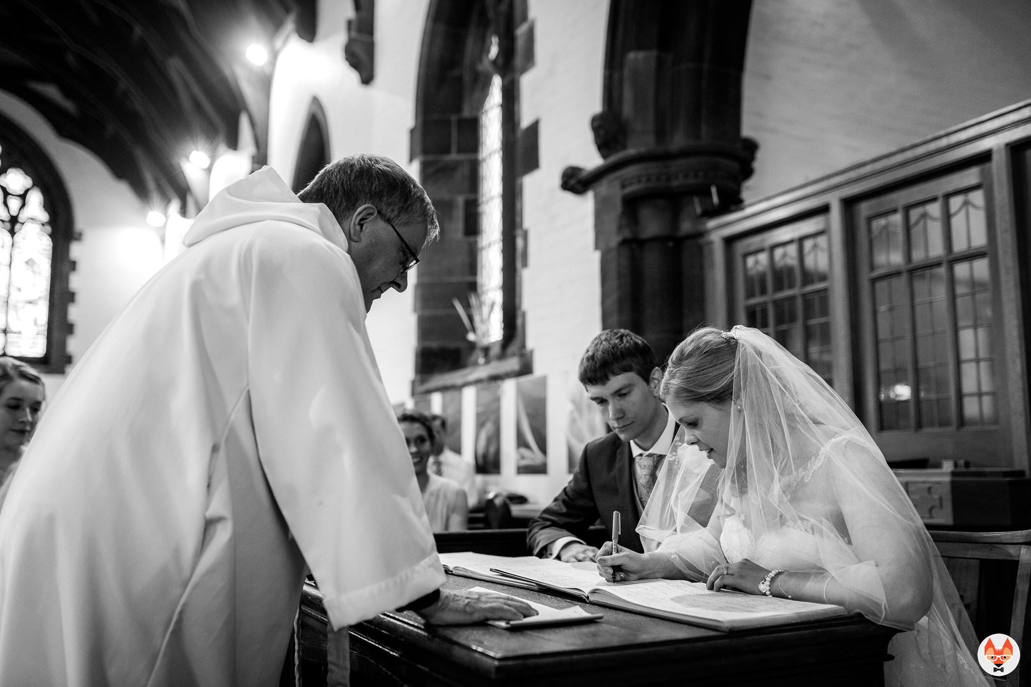 bride signing the register