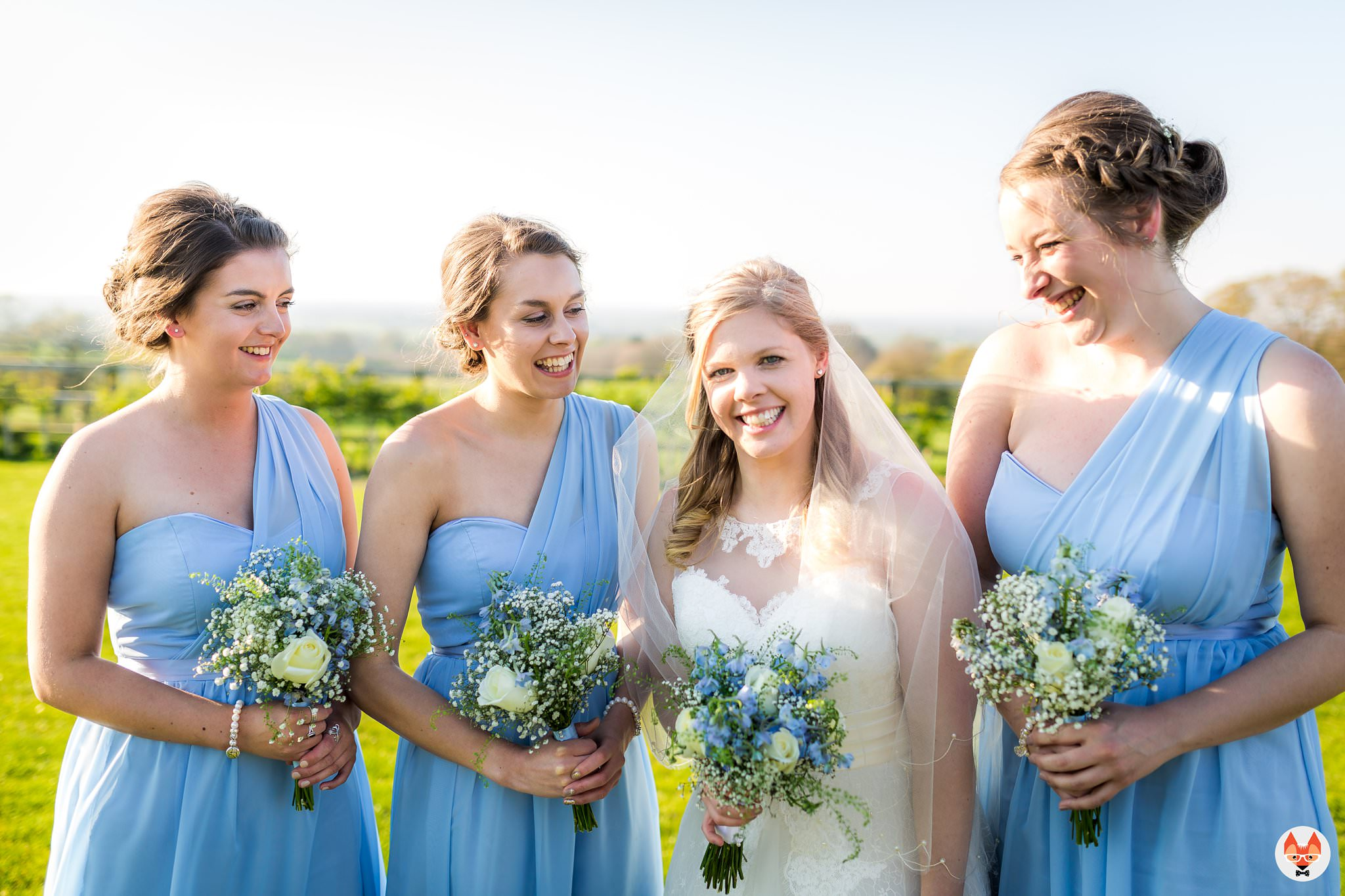 bride laughing with bridesmaids