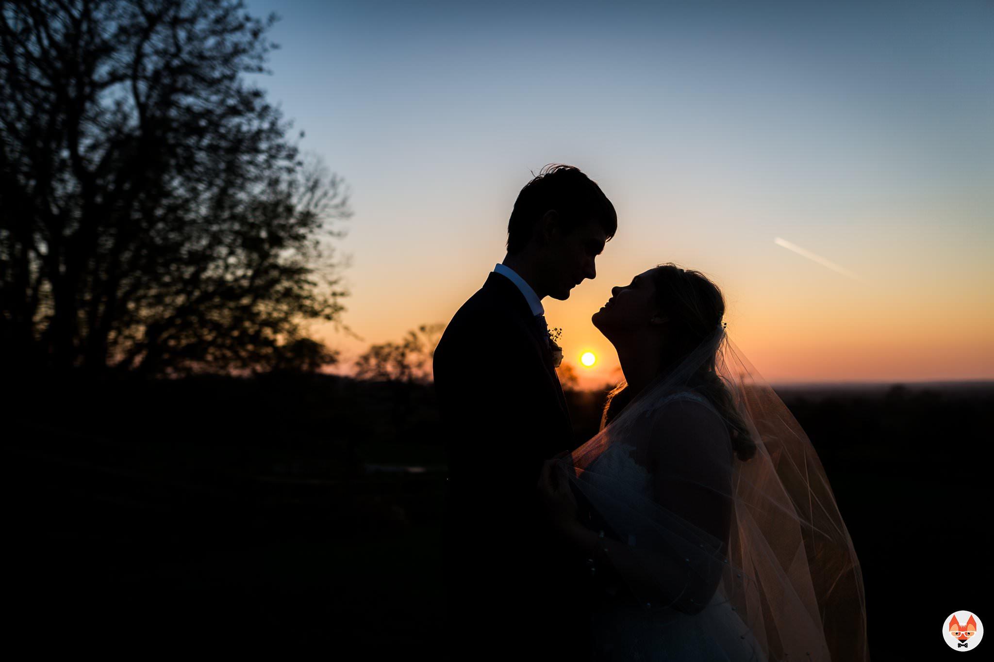 bride and groom portrait as sun sets