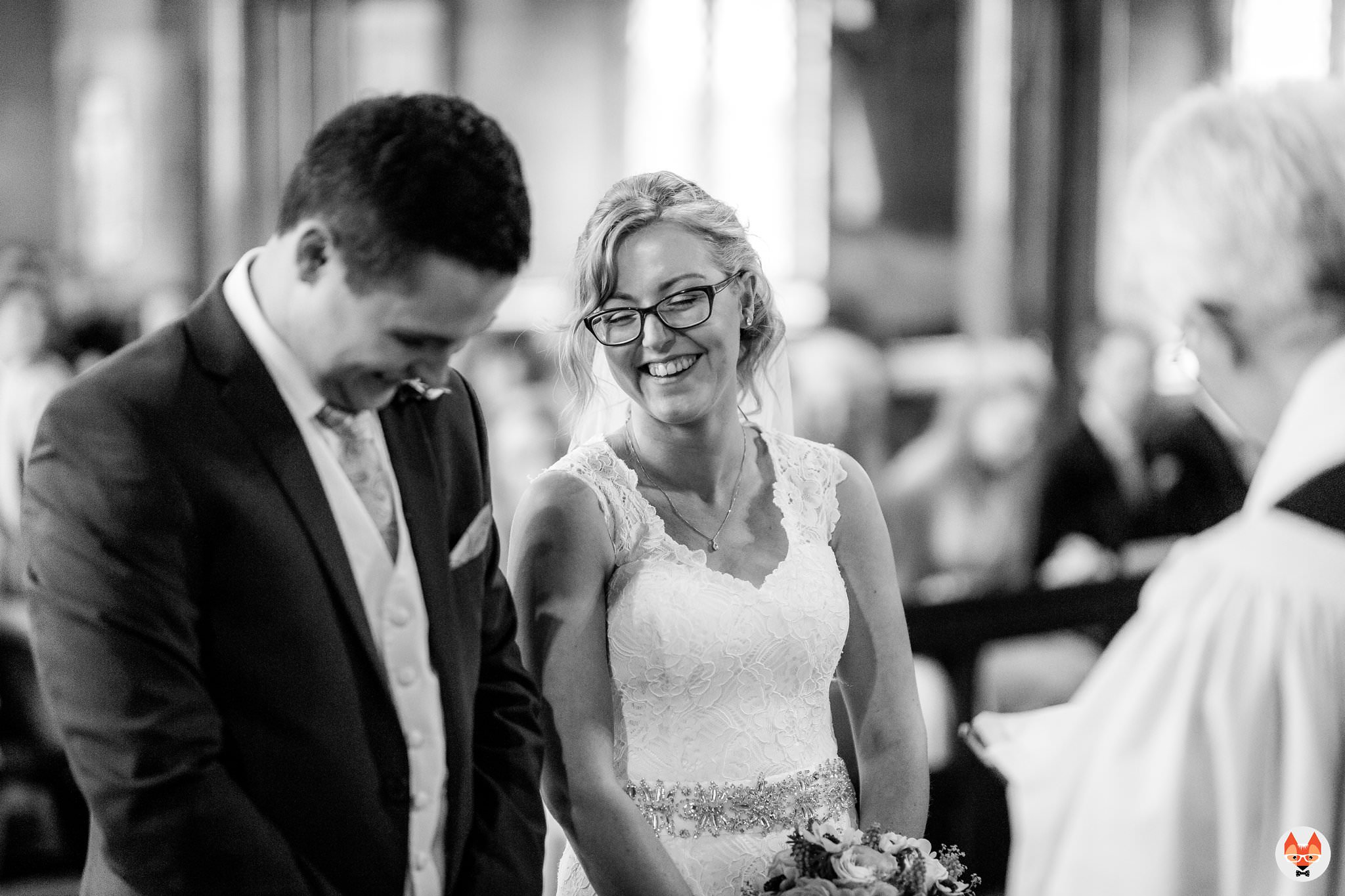 bride and groom laughing during the service