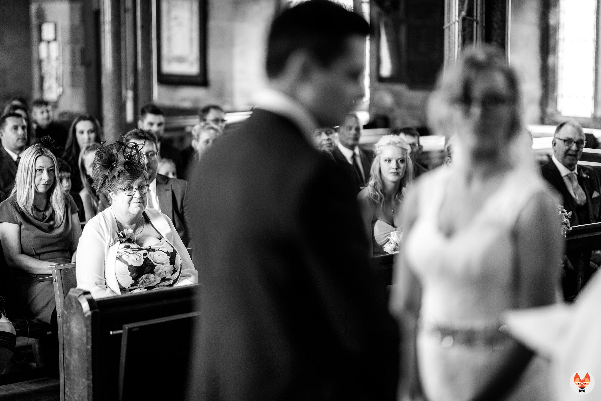 brides mum watching on during the service