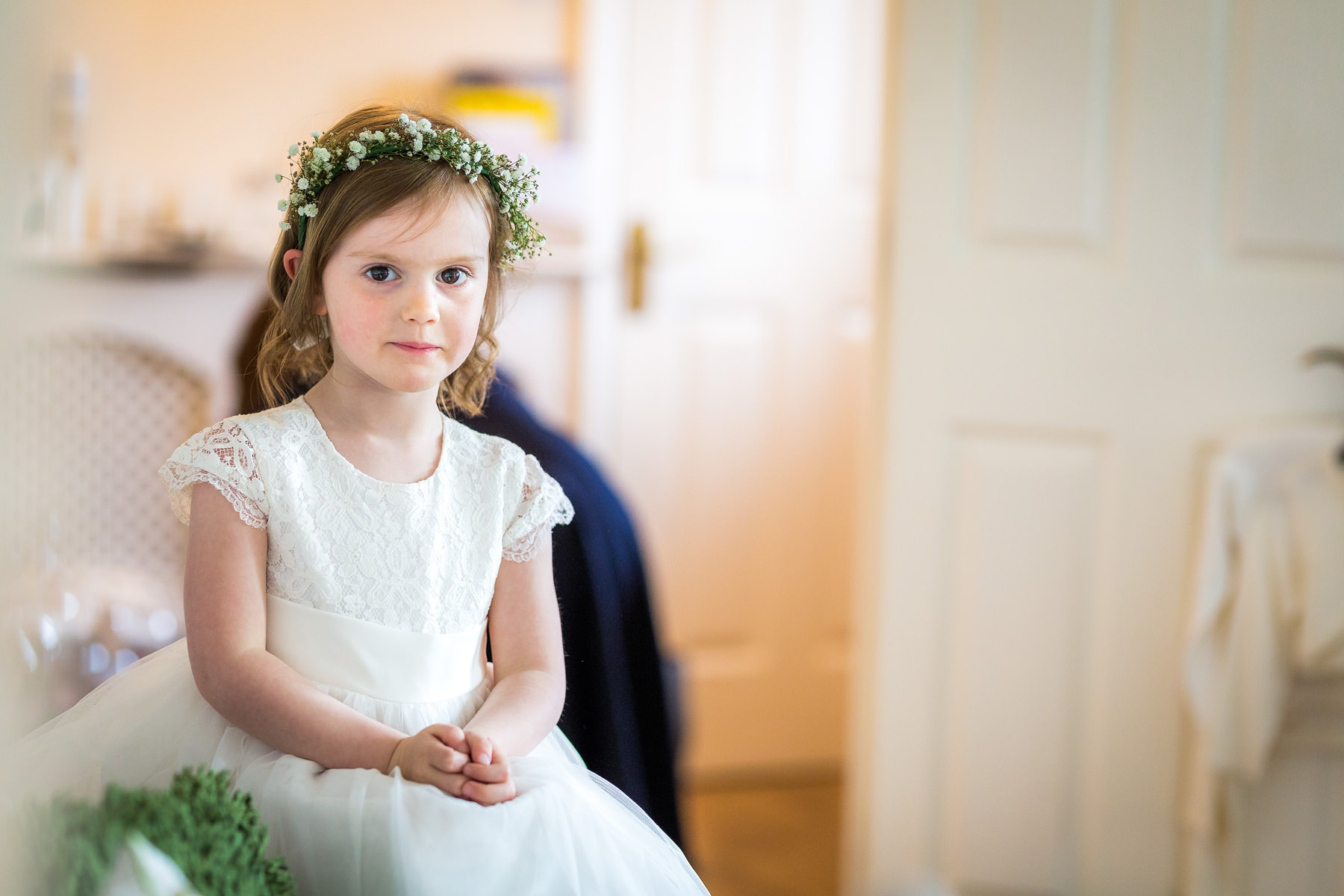 flower girl sat on couch