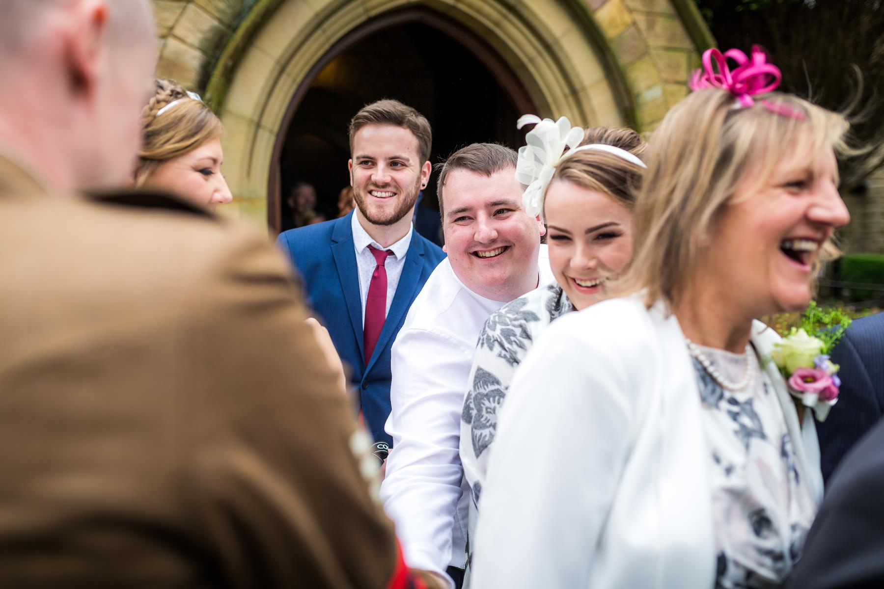 guests greeting bride and groom after service
