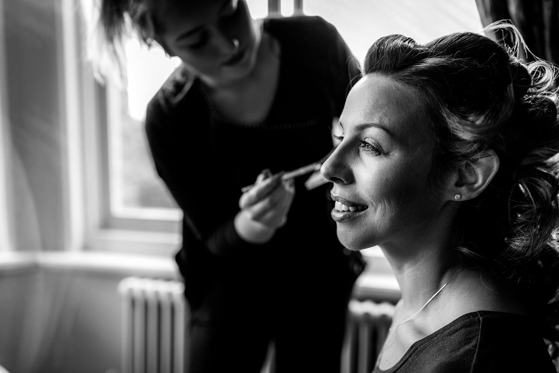 bride having her makeup applied