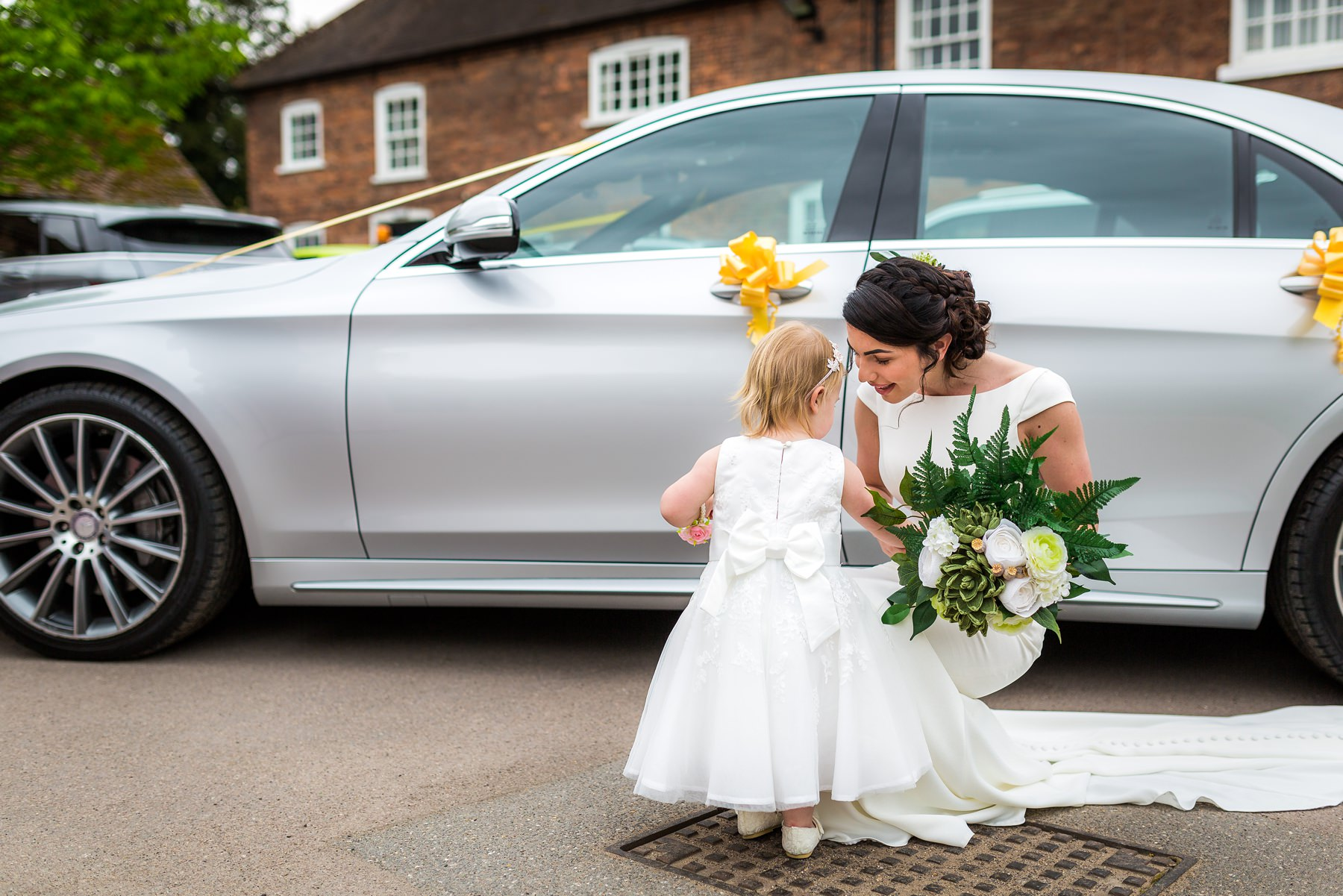 bride greeted by flower girl