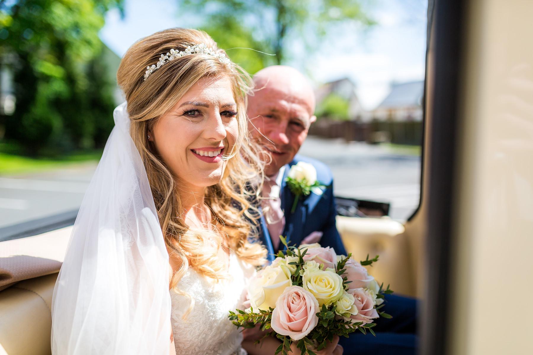 bride arriving with dad in wedding car