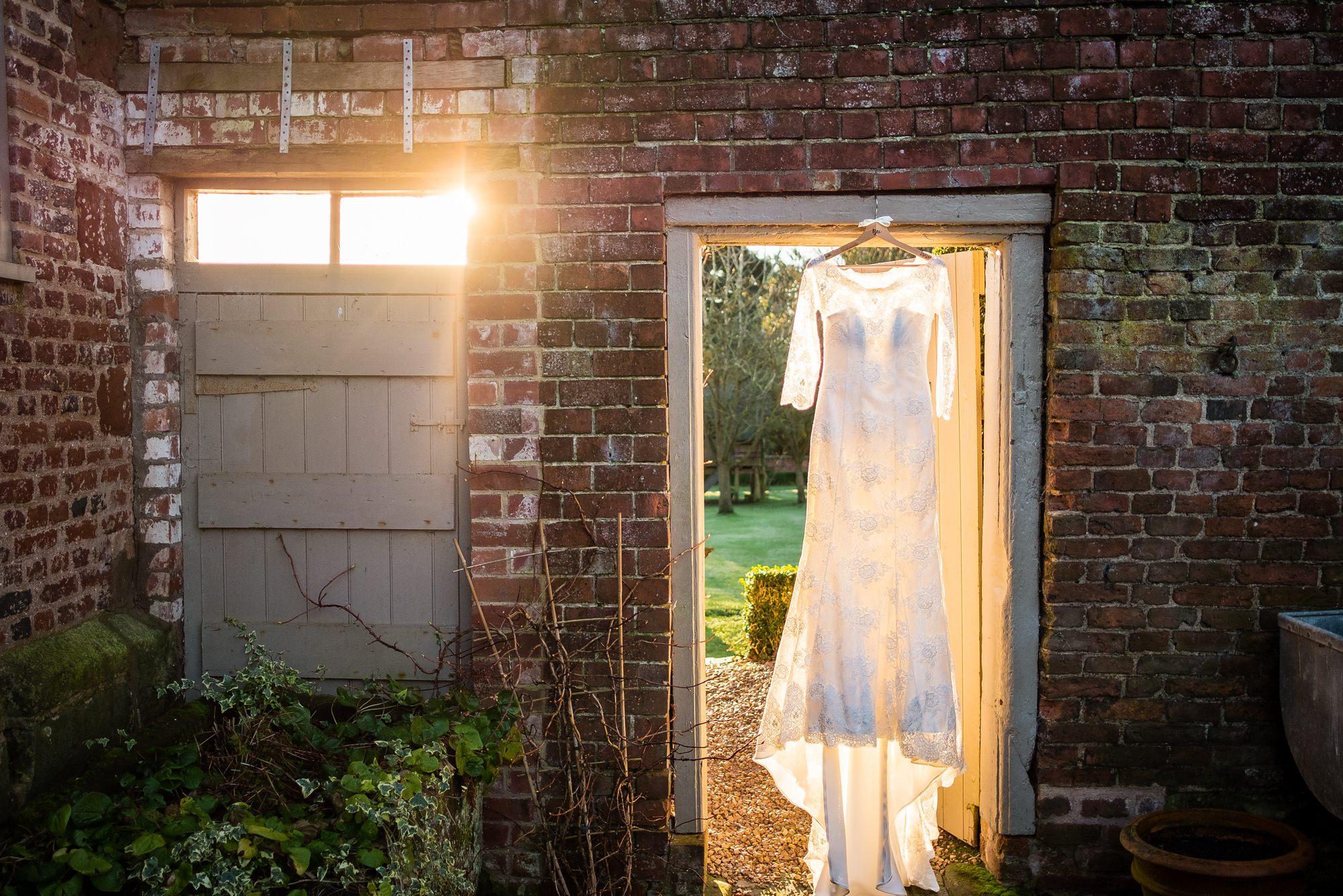 wedding dress hung near pimhill barn