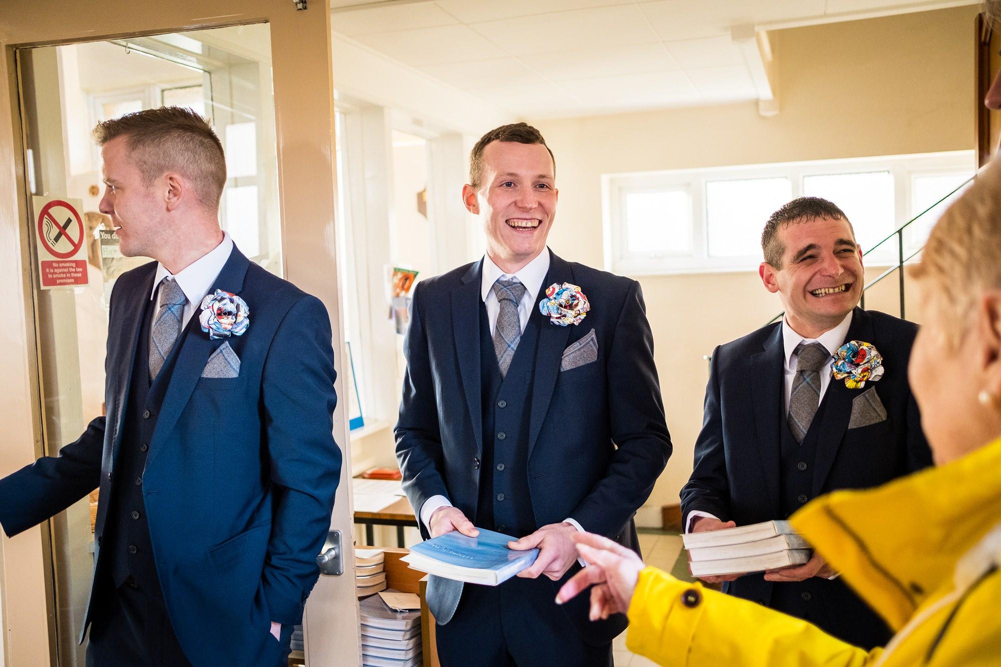 groomsmen greeting wedding guests