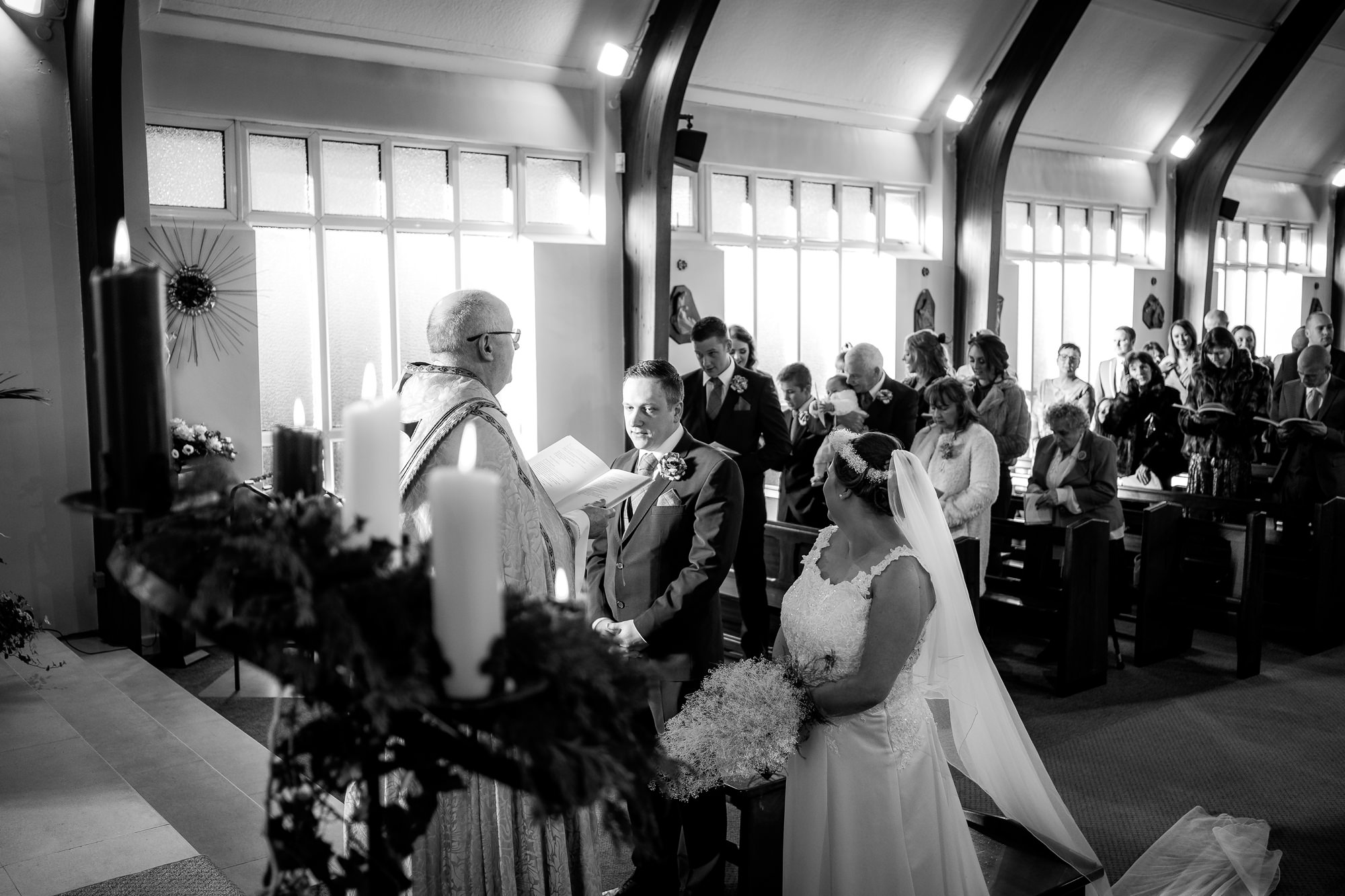 bride greets groom at the end of the aisle