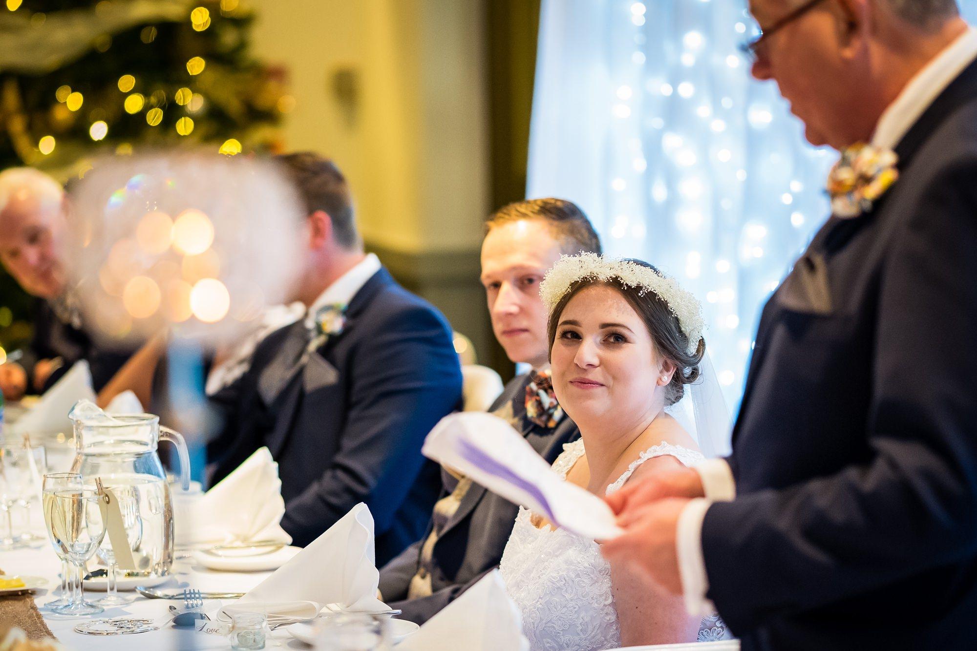 bride watching dad during speeches