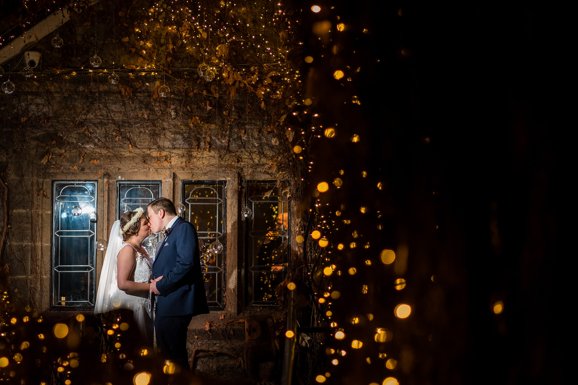 couples portrait with fairy lights