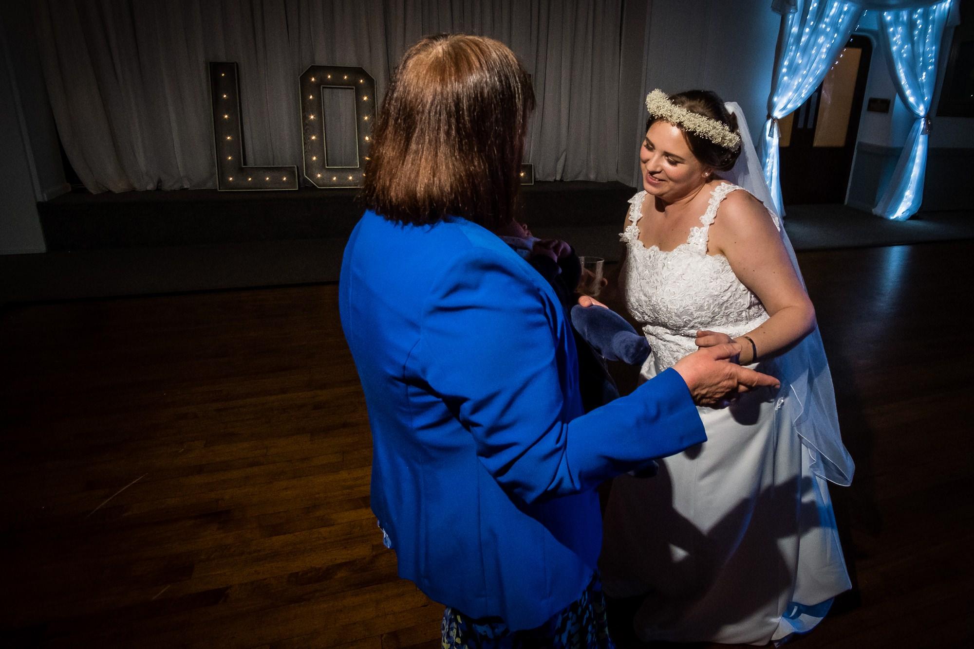 mum and bride dancing