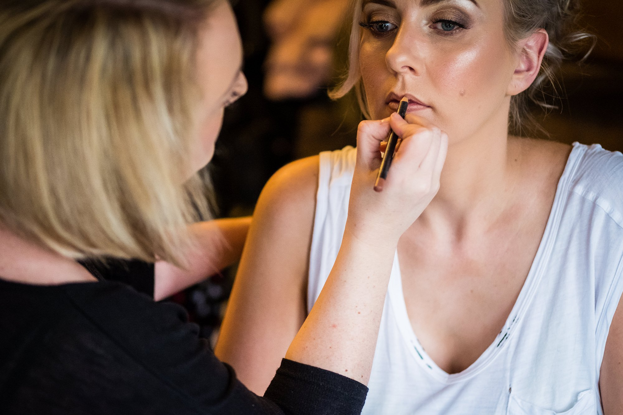 bride having lipstick done