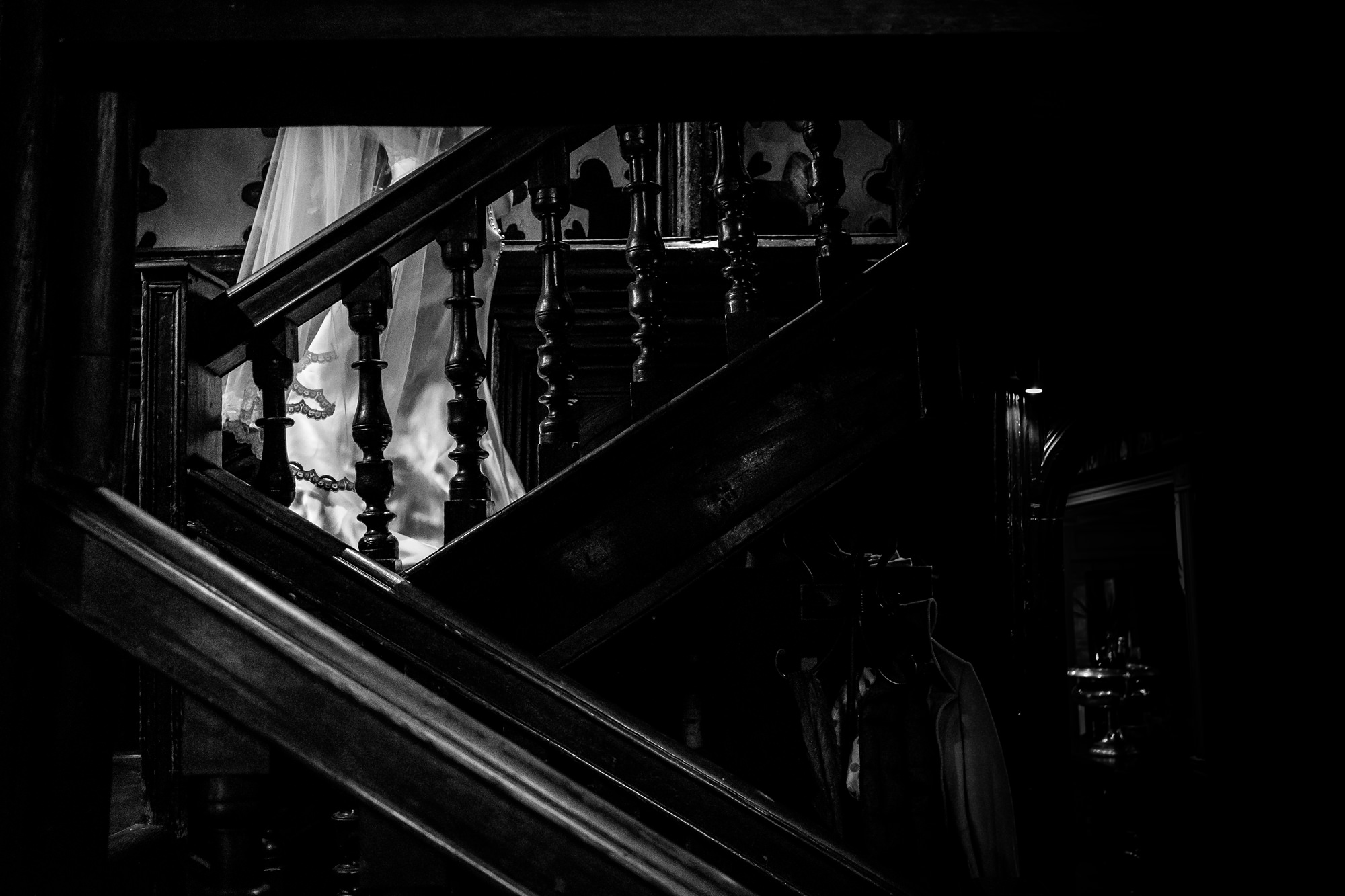 bride walking down the stairs at mitton hall