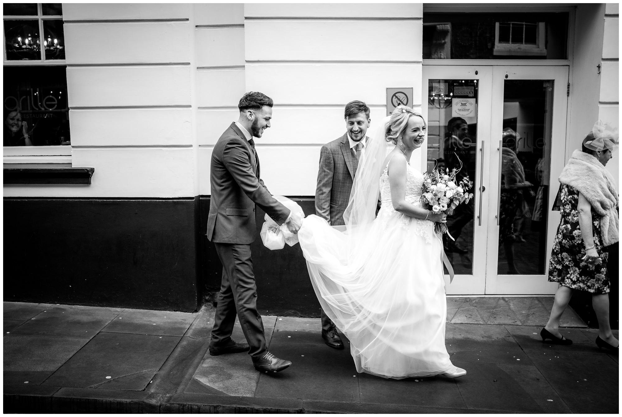 wedding guest carrying dress