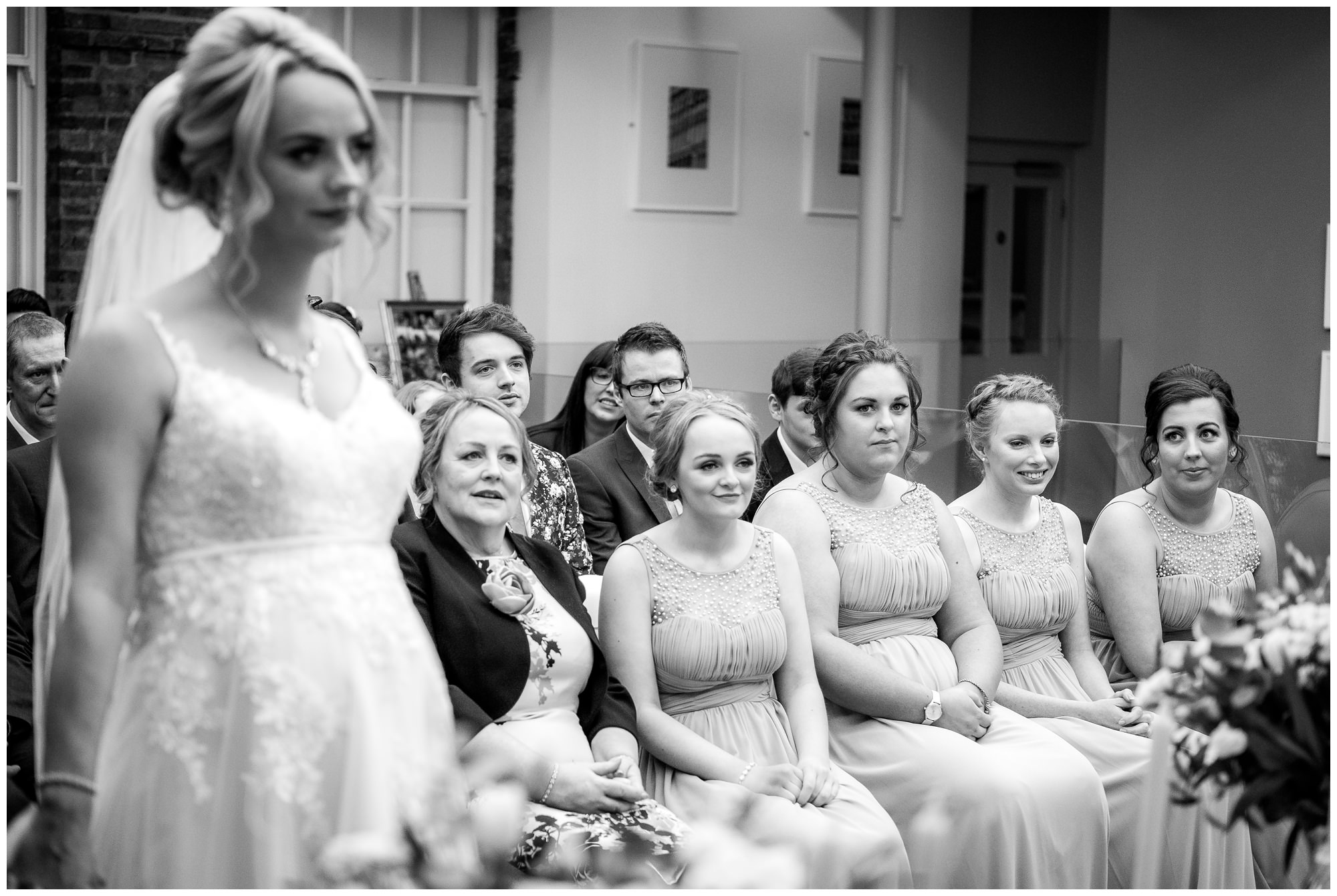 bridesmaids watching on during the service