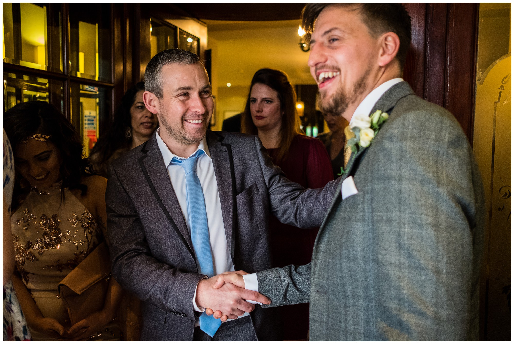 guests shaking grooms hand