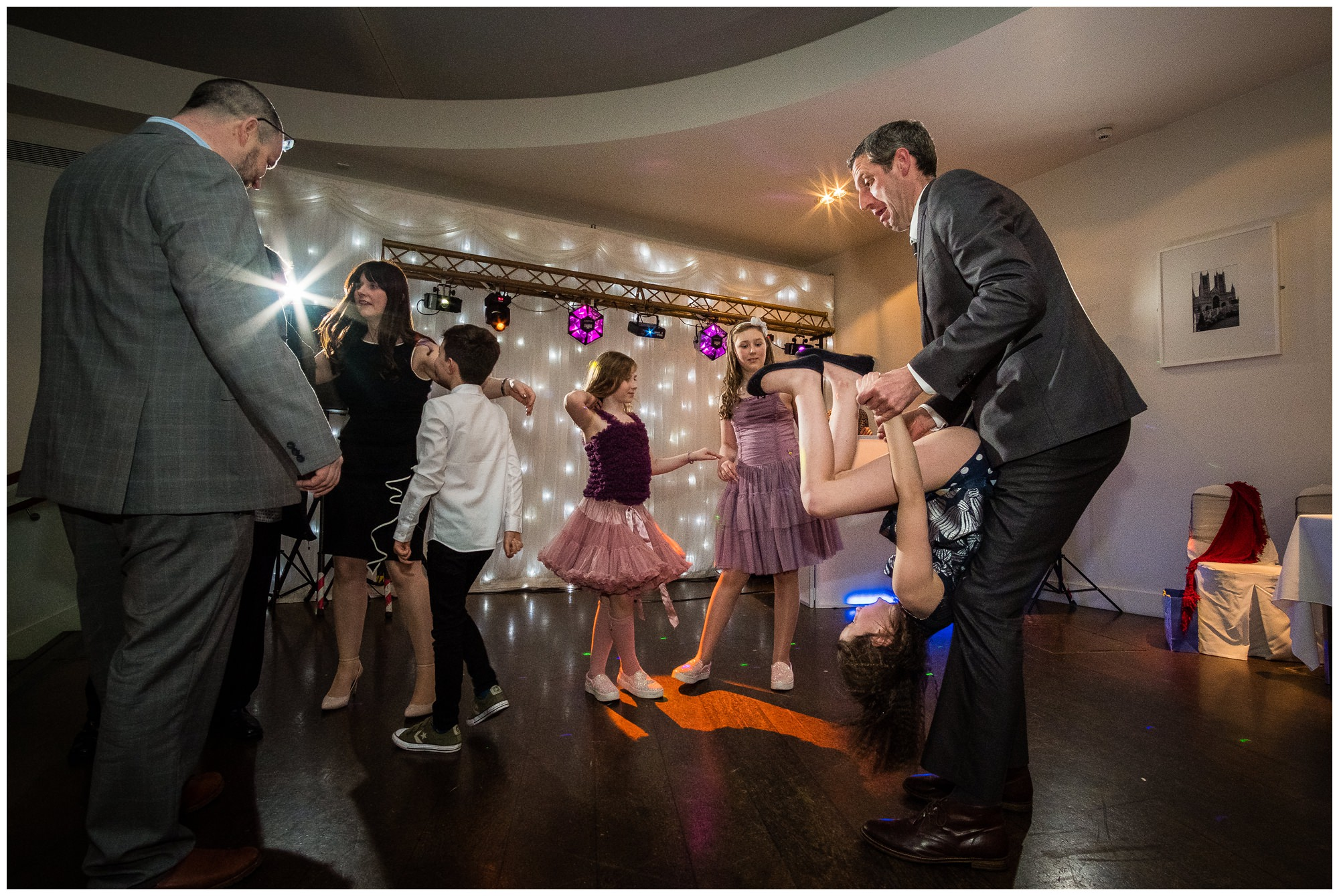 guest spinning child on dance floor