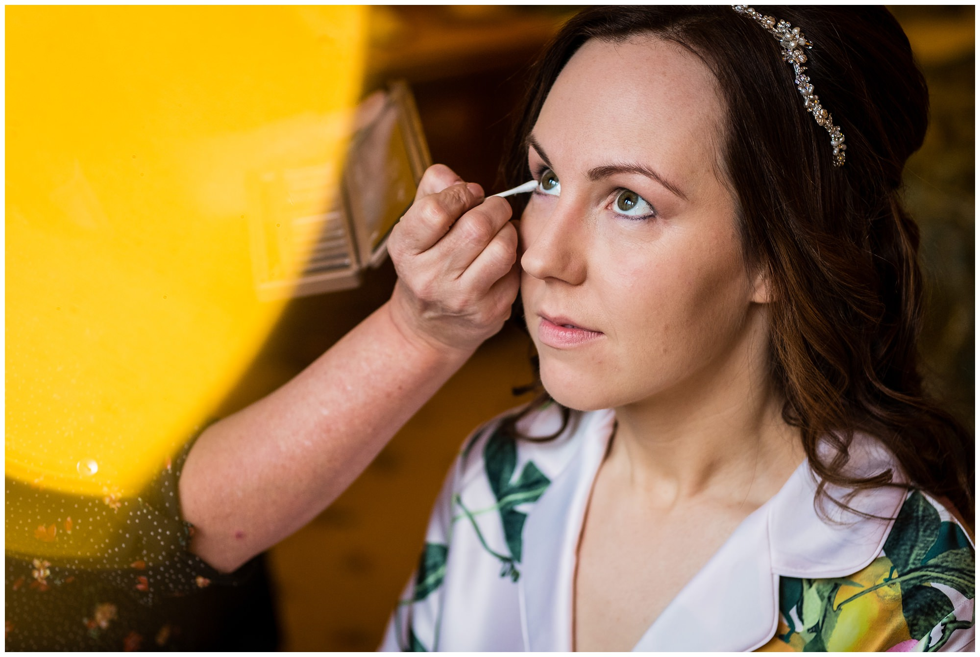 close up of bride having her makeup done