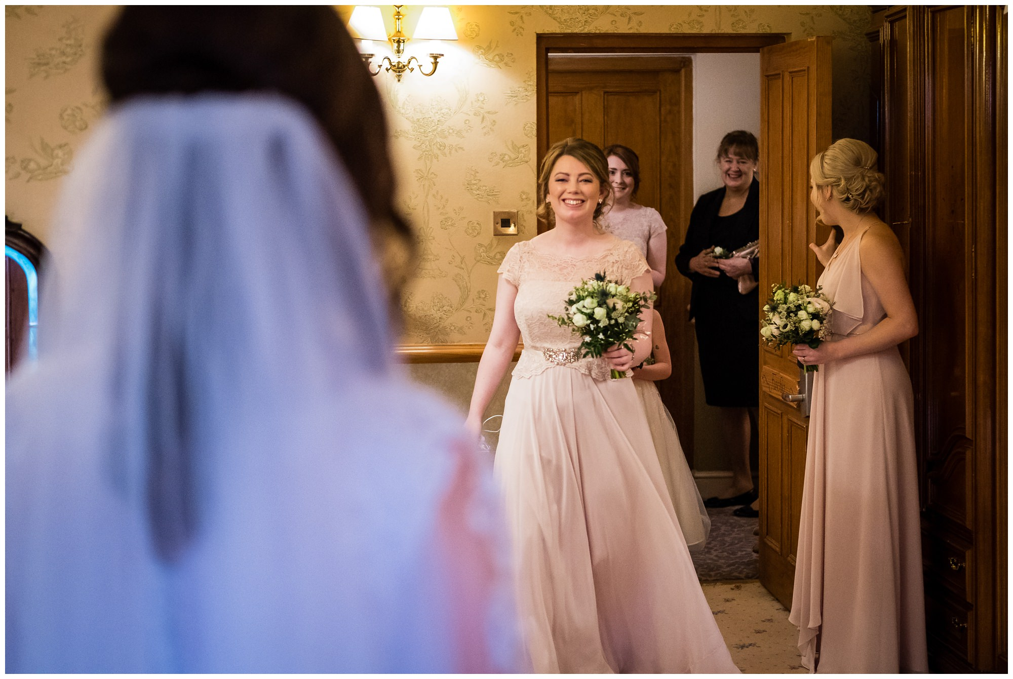 bridesmaids seeing bride for first time in dress
