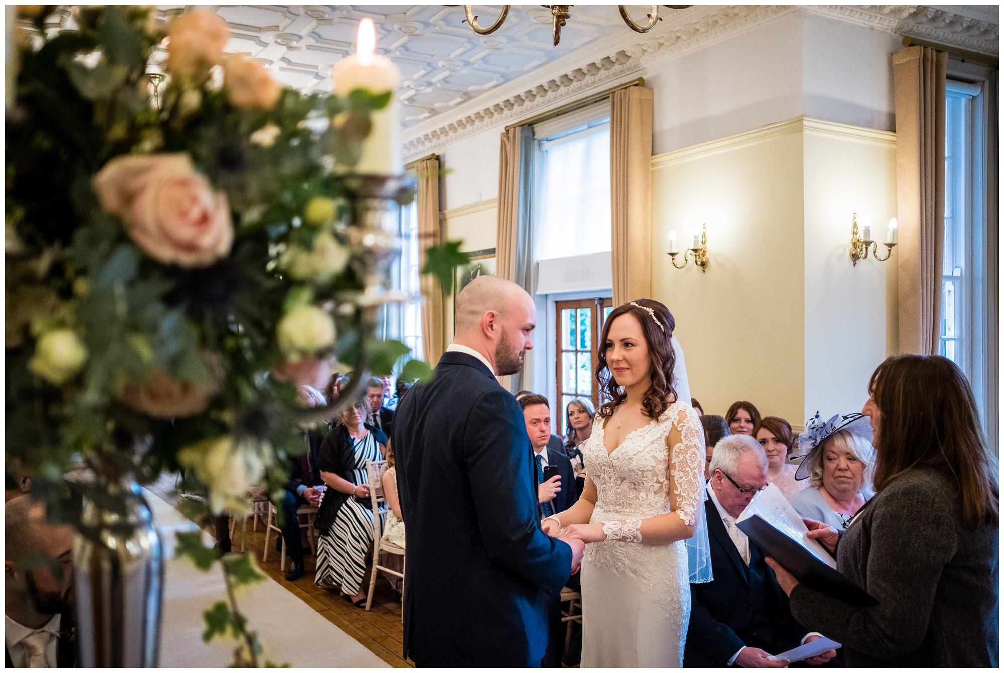 bride and groom holding hands during service at nunsmere hall
