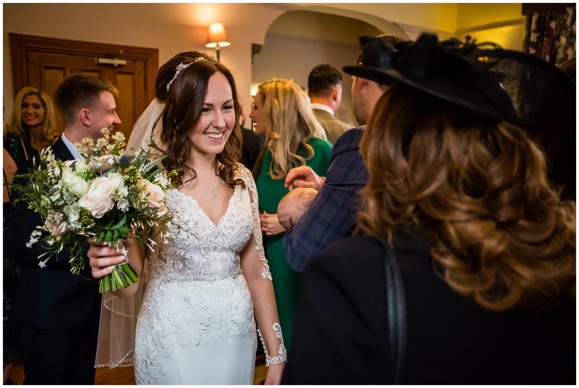 bride smiling with guests