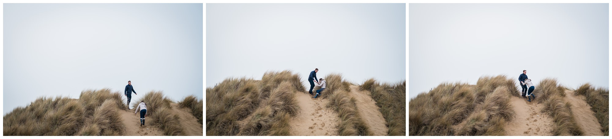 bride and groom to be climbing sand dunes