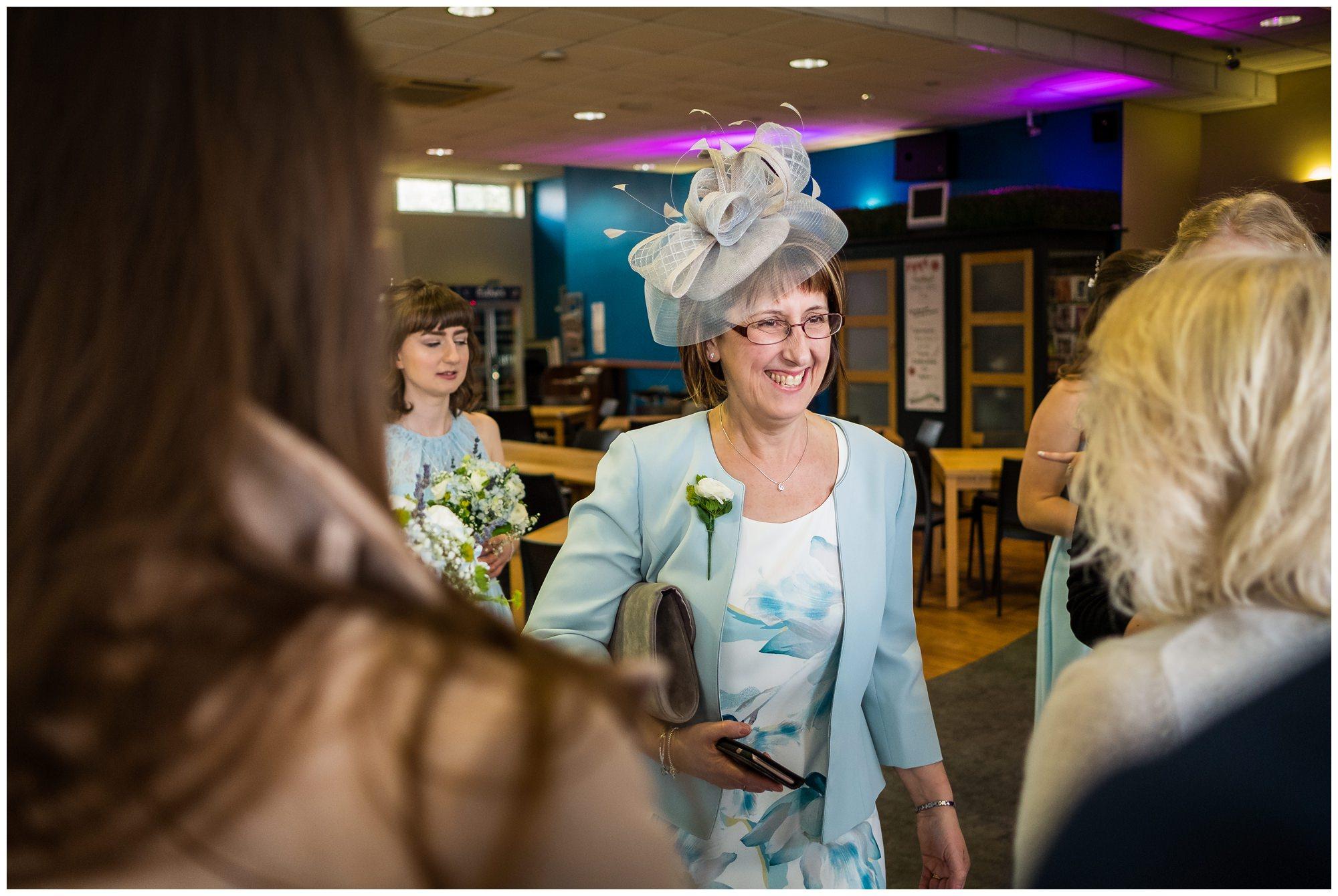 brides mum greeting guests