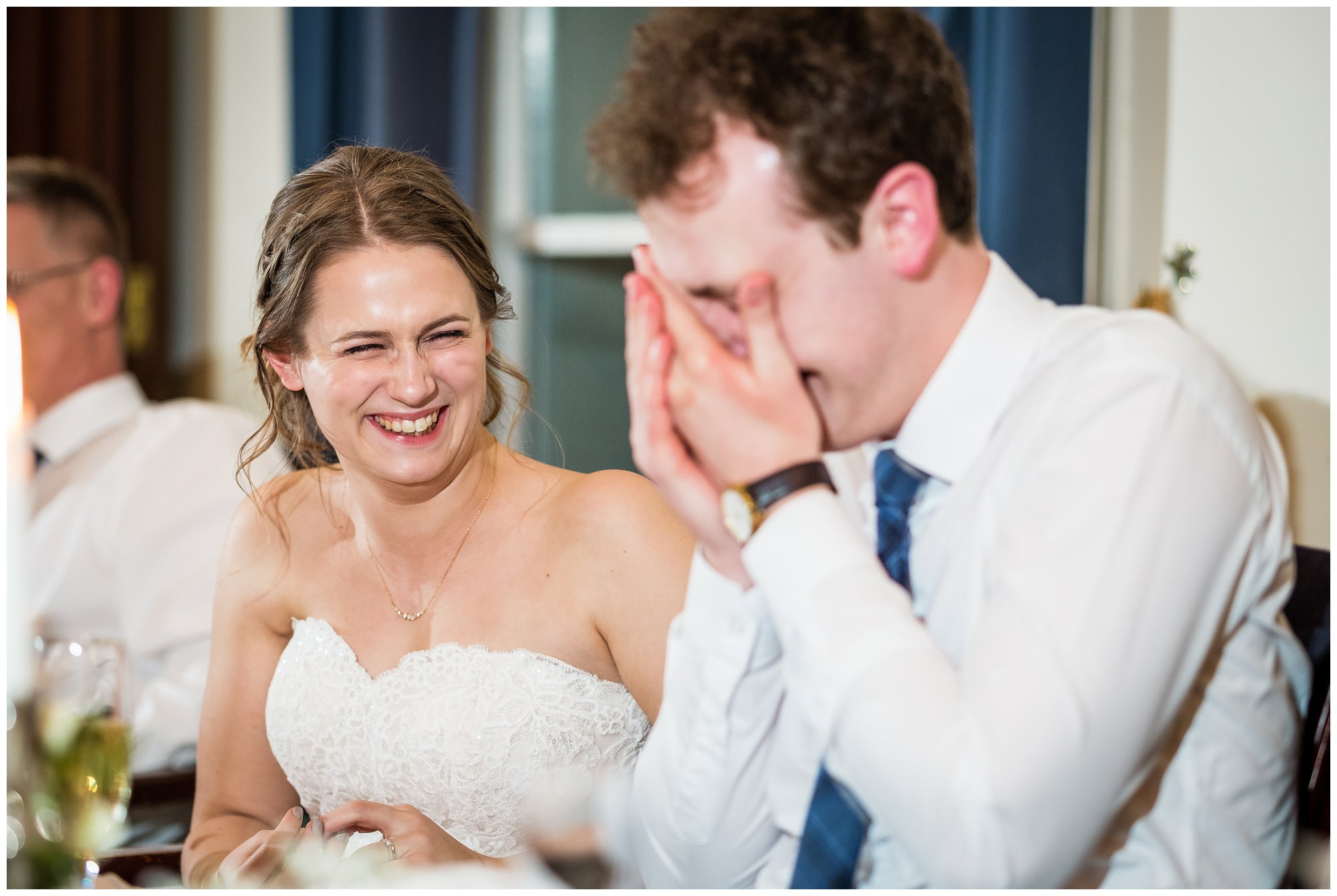 groom hiding his face during speeches