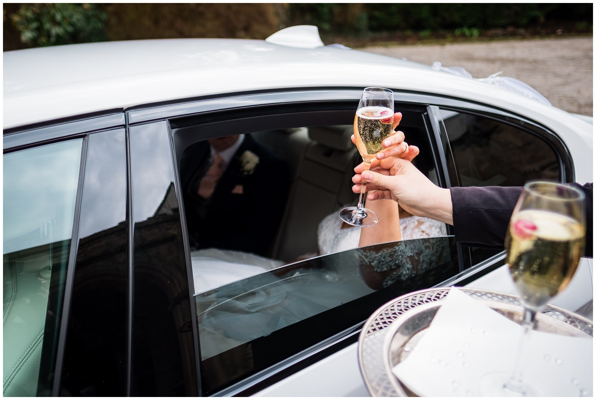 bride receiving her first drink at mitton hall, lancashire