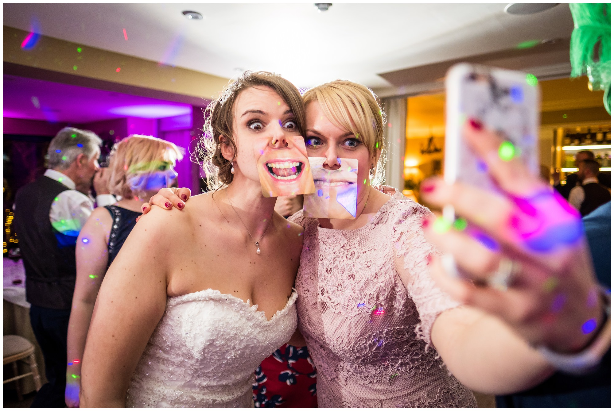 bride taking a selfie with guest