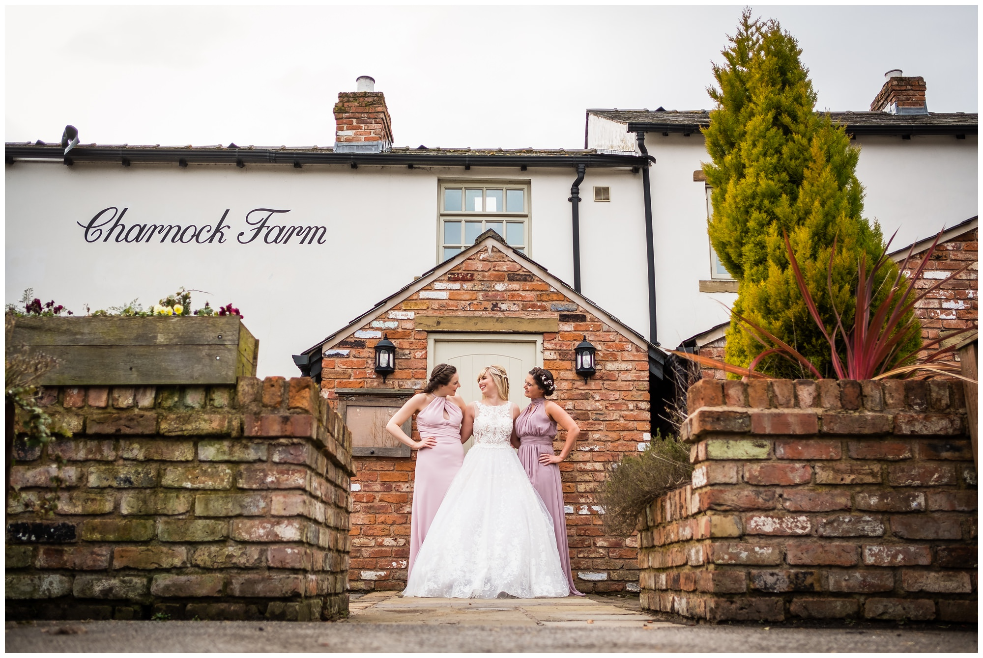 bridal party laughing outside charnock farm