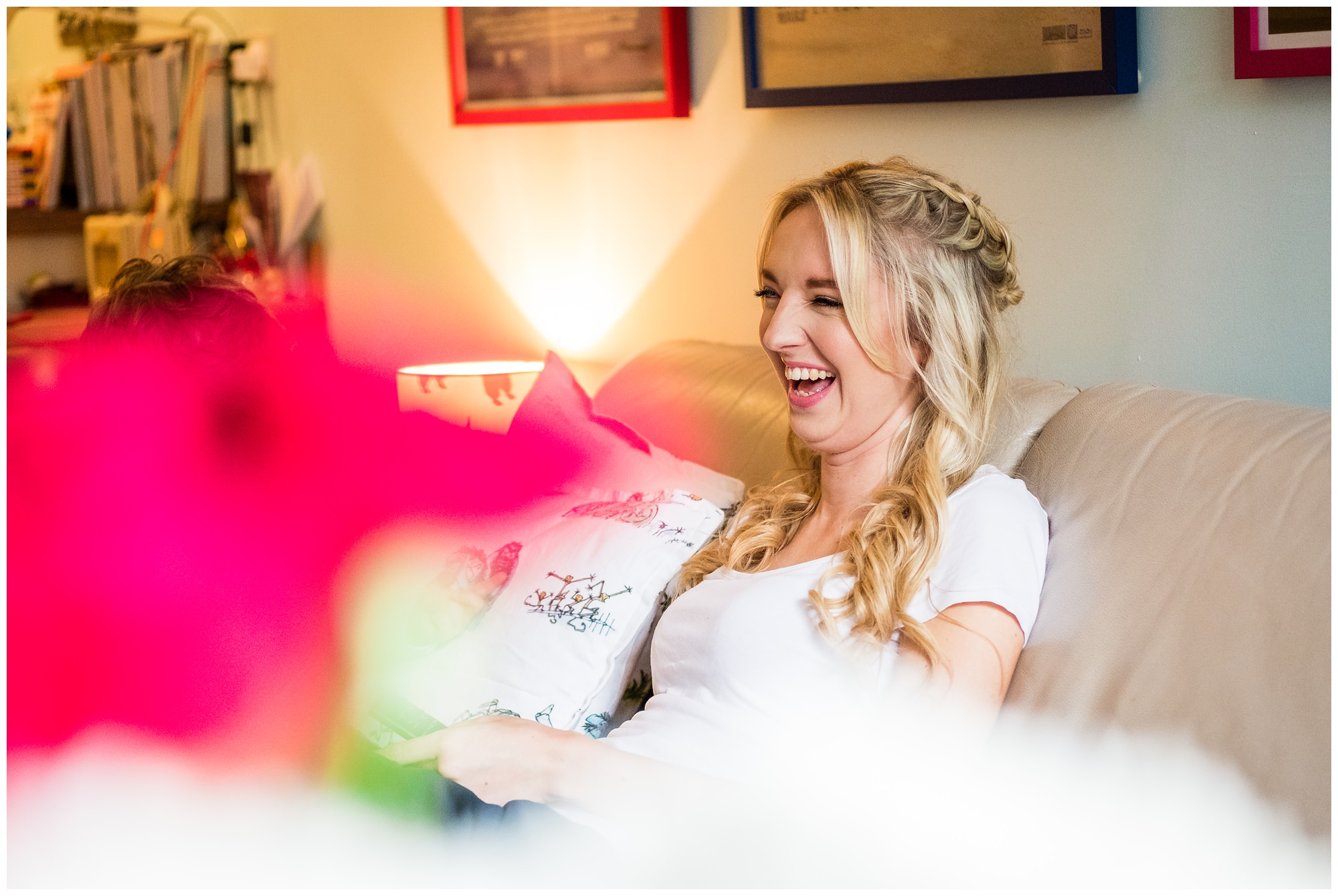 bride laughing on couch