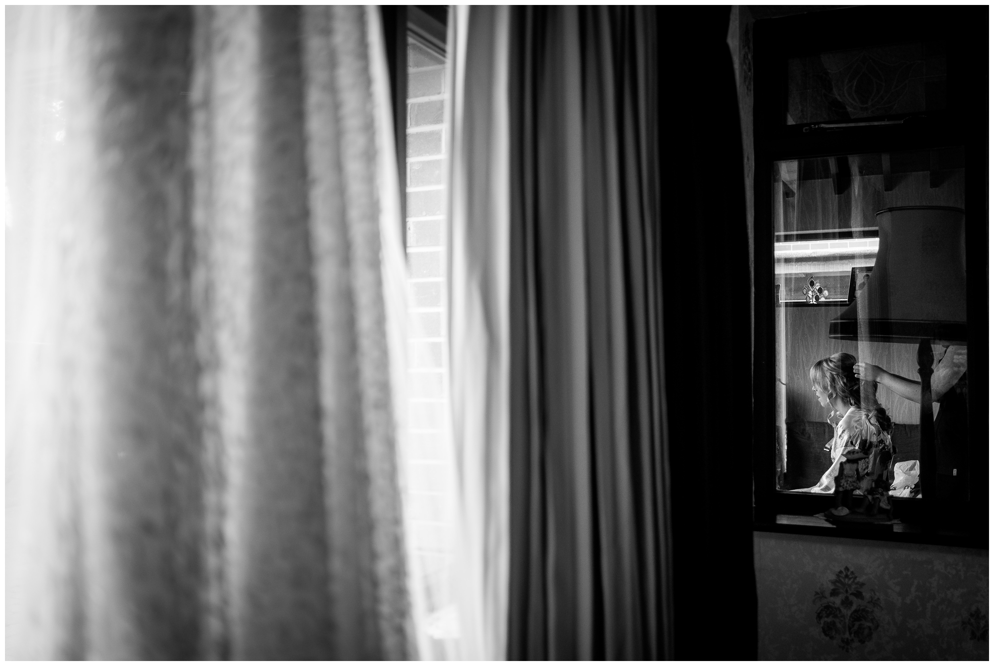 bride getting ready through window