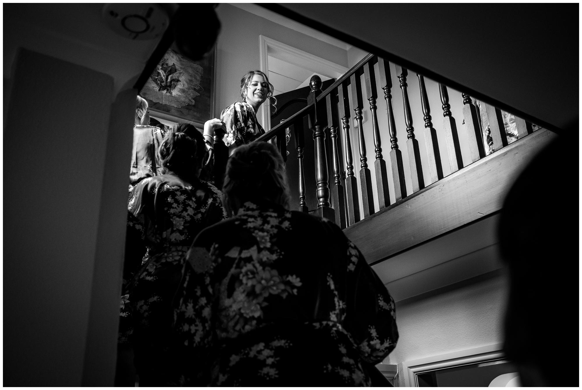girls making their way up stairs