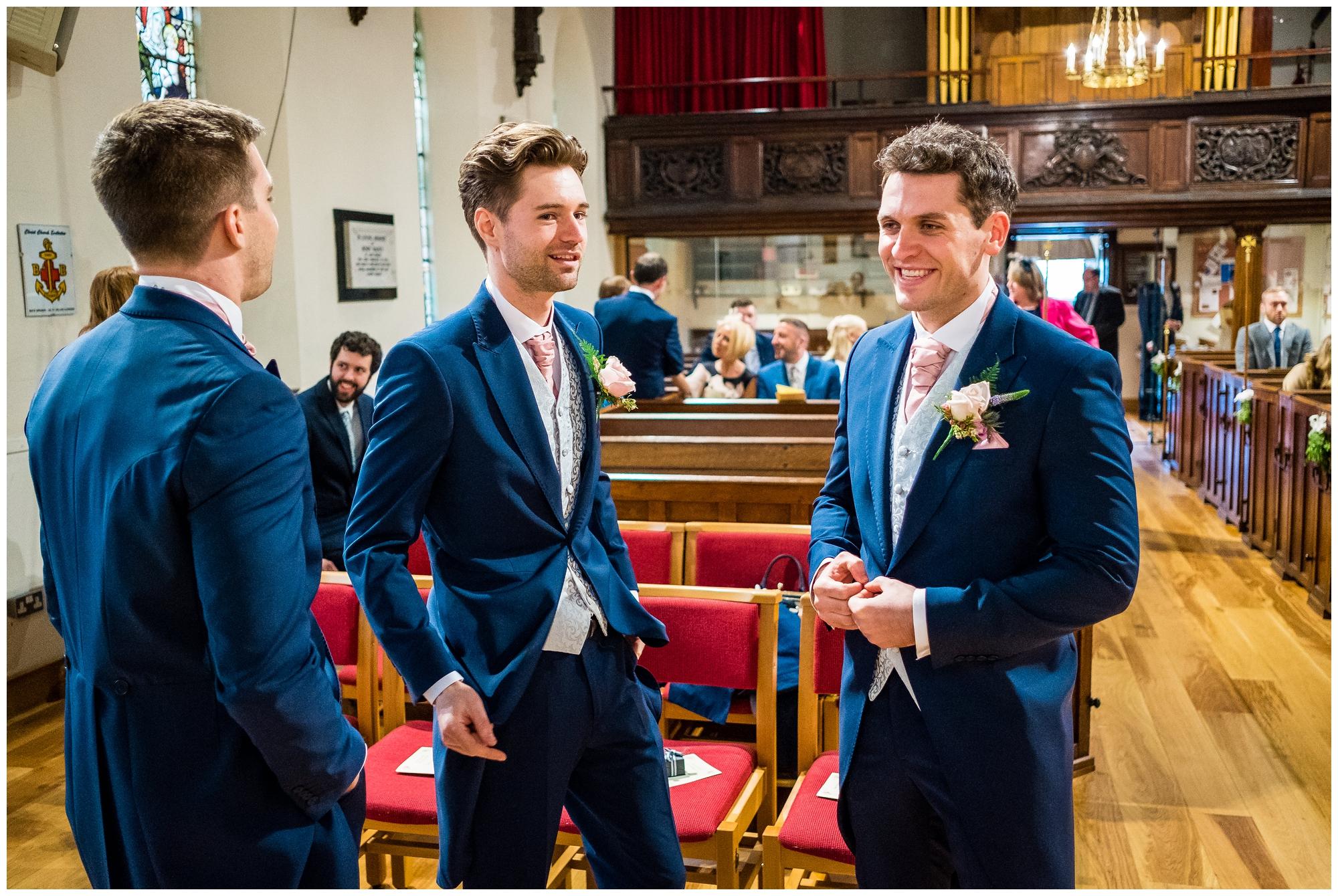groom waiting with groomsmen