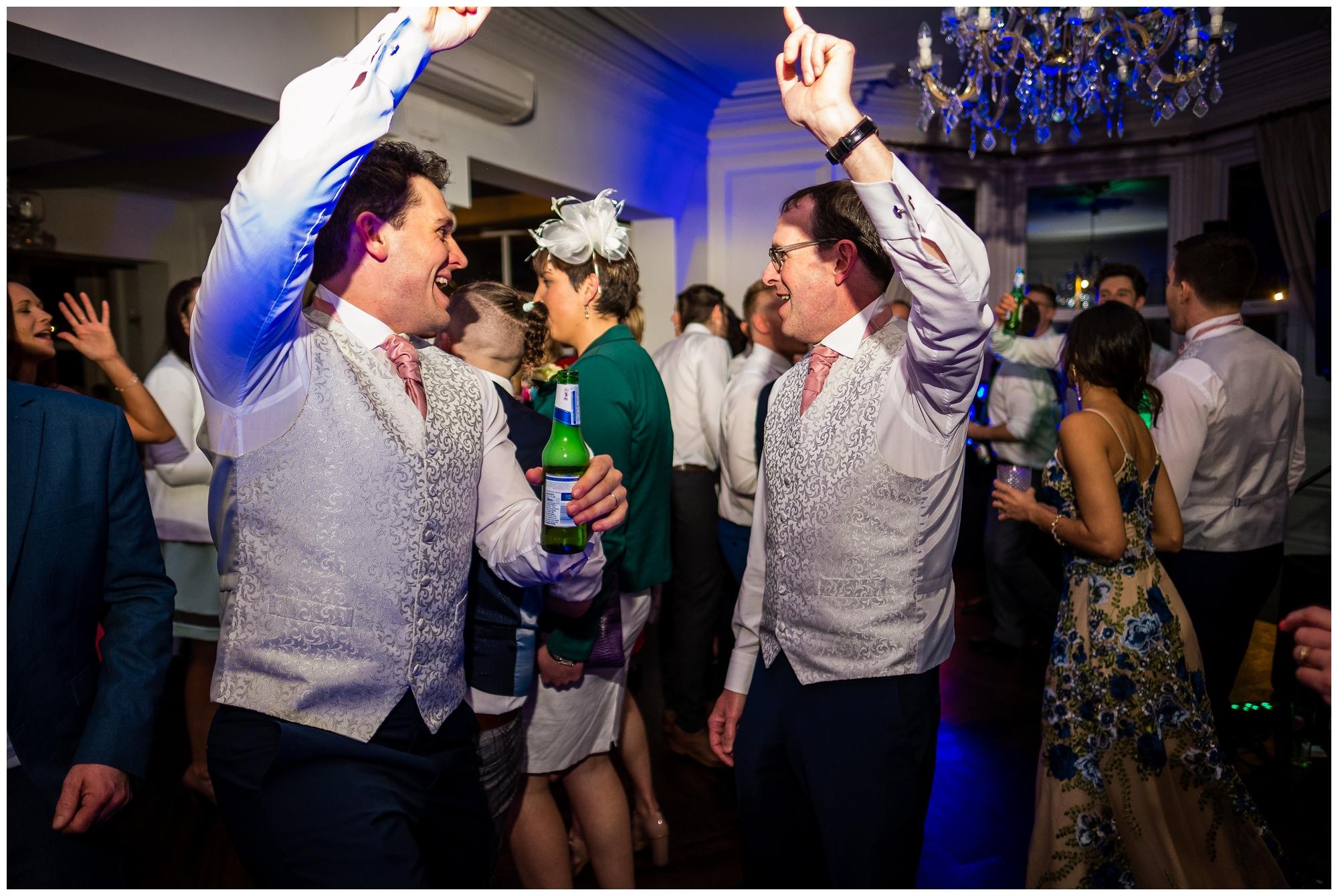 groom dancing with dad