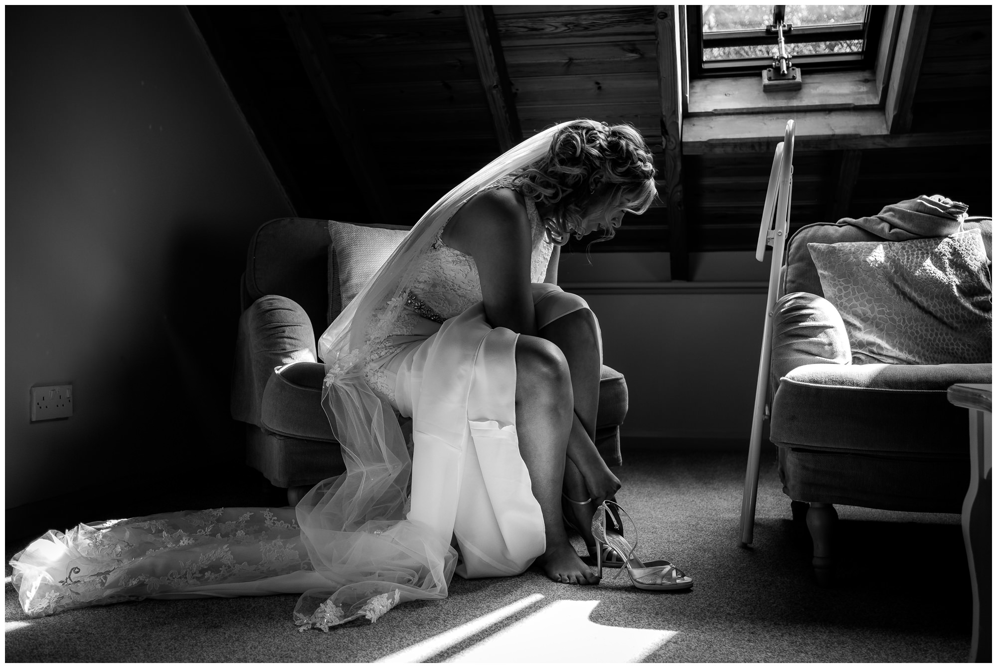 bride putting her wedding shoes on