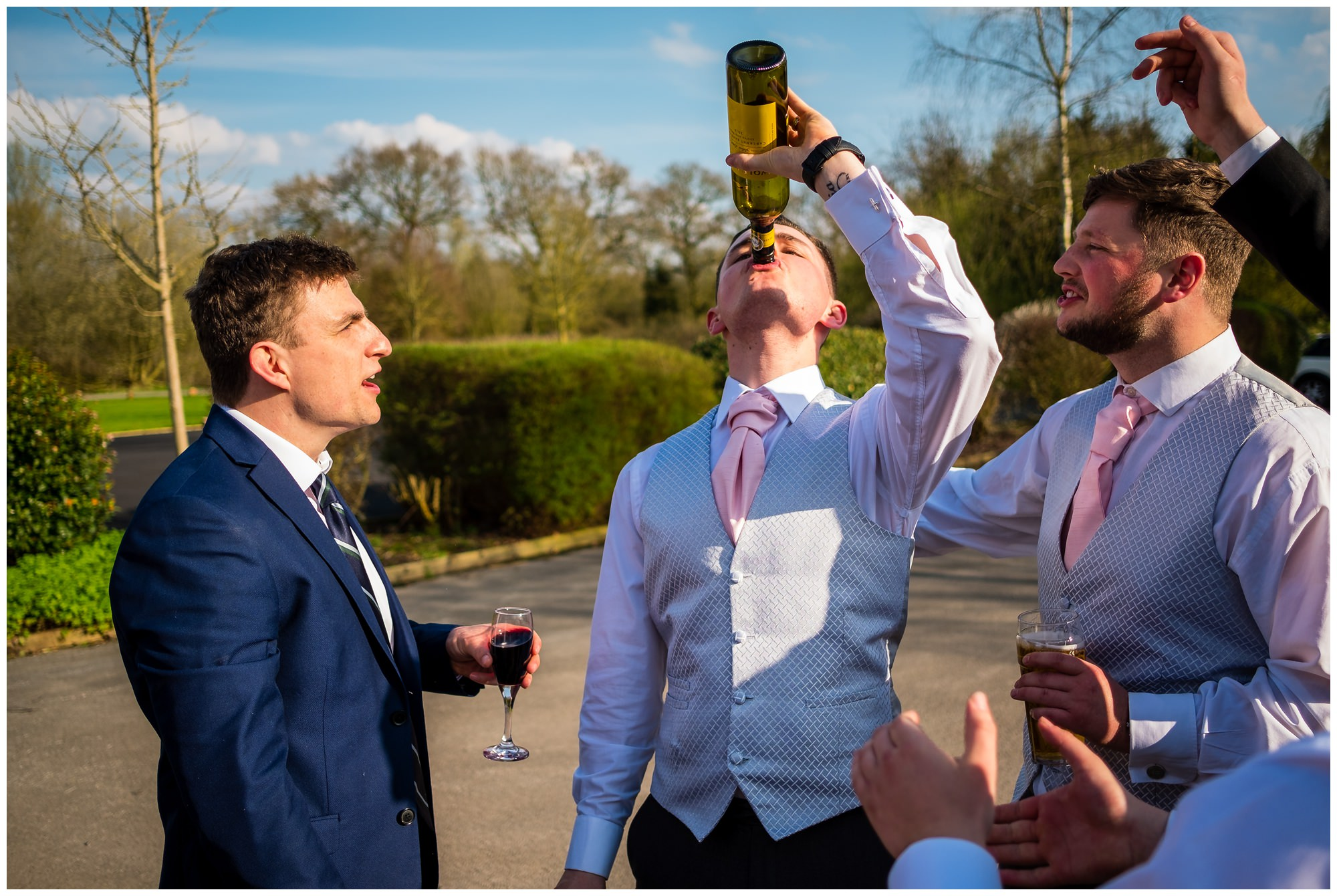 groom drinking wine