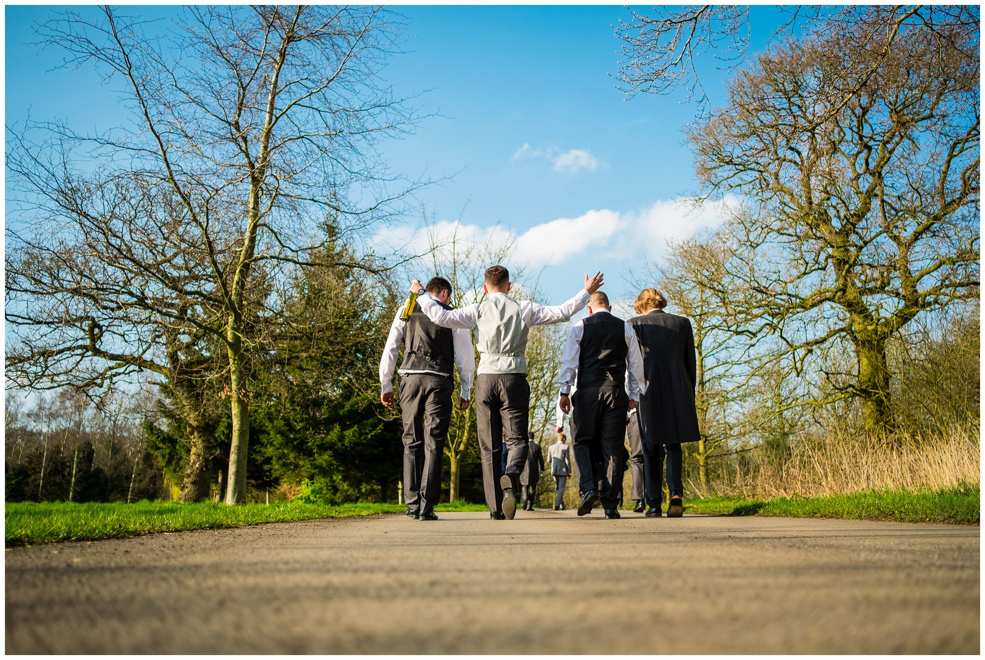 groom and friends going for a walk