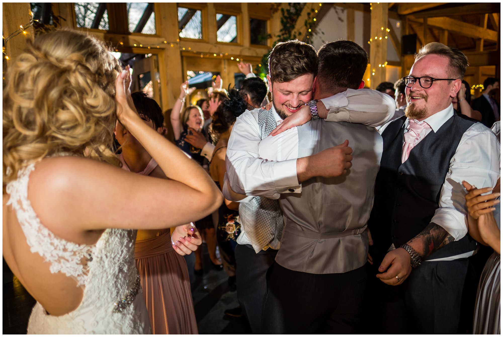 guests hugging on dance floor