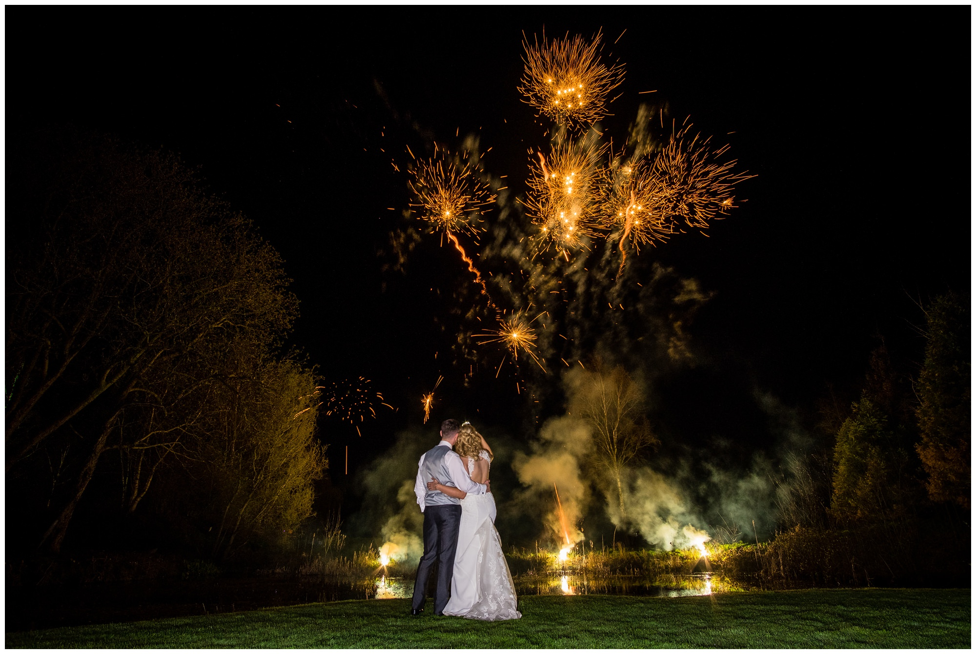 bride and groom during firework display