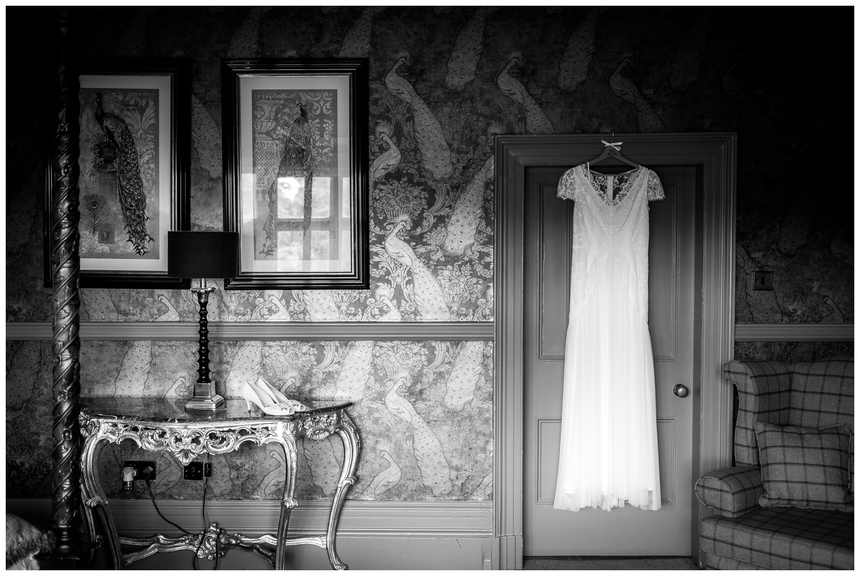 wedding dress hung at mitton hall